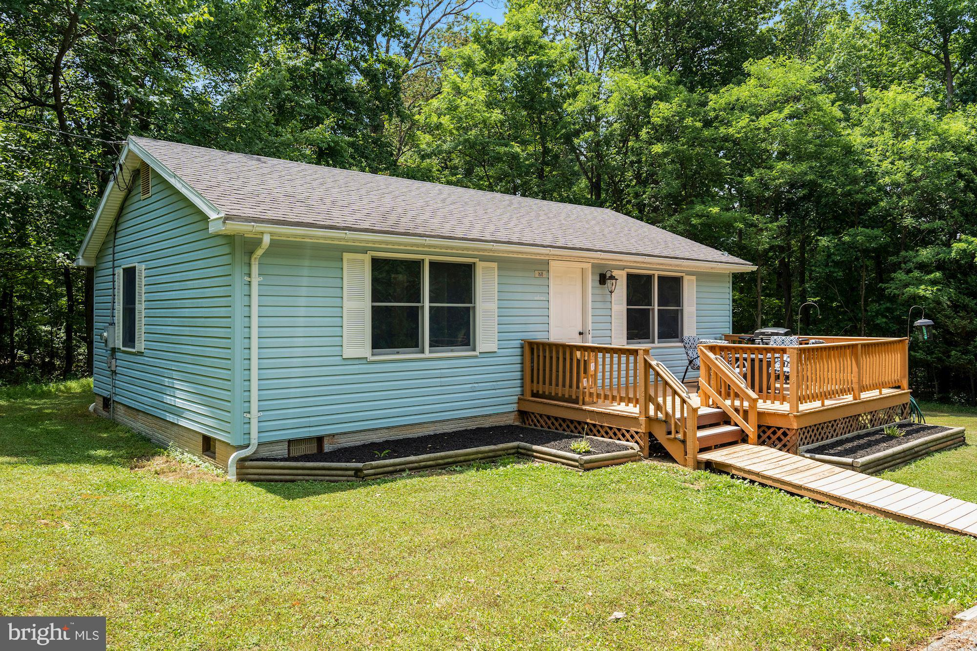 Super cute rambler on almost an acre in Bluemont! Quick easy access to Route 7.  Surrounded by woods