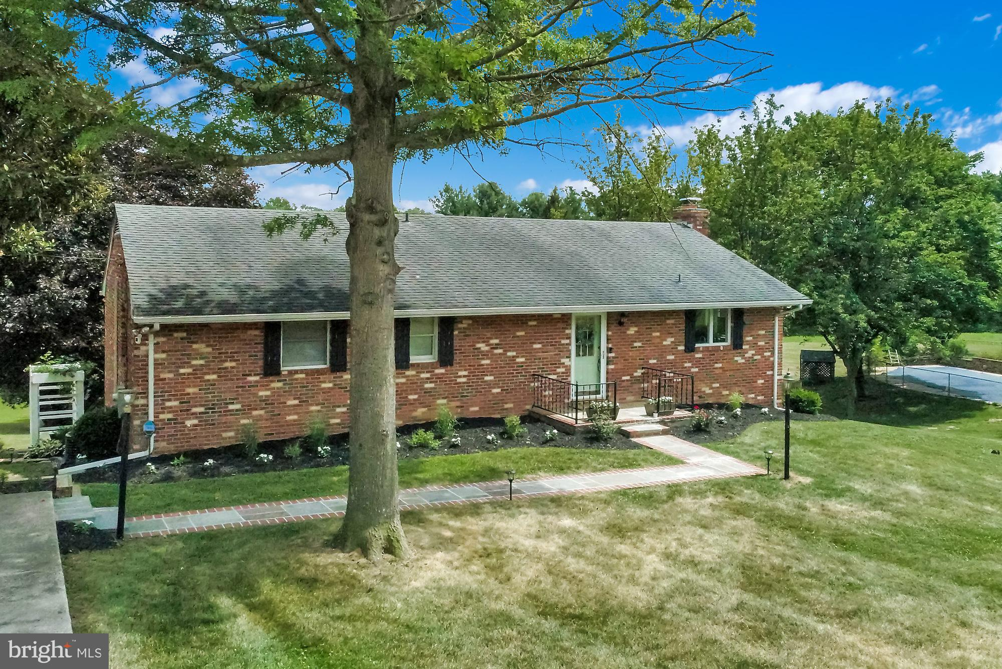 Charming all-brick ranch home on a beautifully landscaped lot, is nestled in the heart of Finksburg.