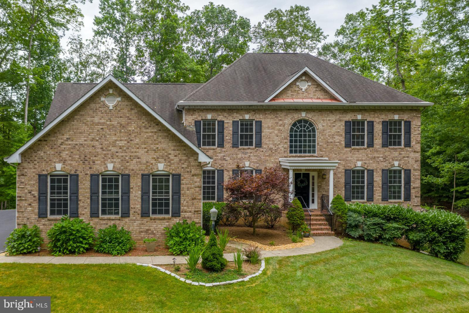 WELCOME TO YOUR OWN PRIVATE RETREAT!Stunning, well maintained Brick Front Colonial on almost 3 acres