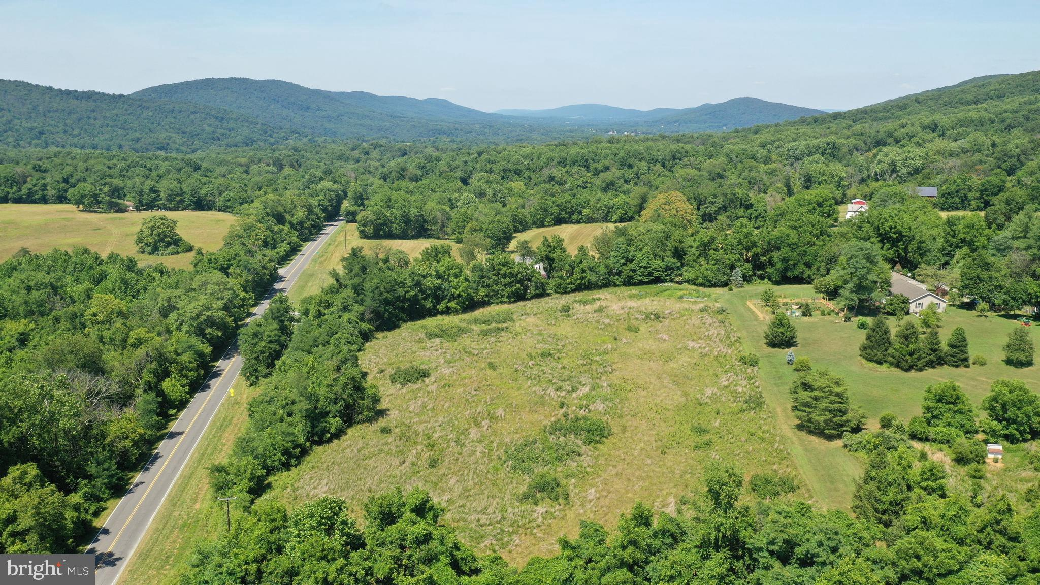 Build your dream home here! 21+  private acres off of Snider lane in the Hillsboro area.  Lovely land with gentle slope and mountain views.  Enjoy the country community with nearby Nell Boone park and Community Center.  Surrounded by trees and beautiful vistas,  just up the road is the Blue Ridge Center for Environmental Stewardship. A 900 acre nature preserve with trails and events centered on nature and wild life preservation.  Located near the Appalachain trail, surrounded by wineries, breweries and farm to table dining.  Minutes to Historic Harpers Ferry, West Virginia.  Currently in open space land use which expires in December 2020. Seller not responsible for rollback taxes.