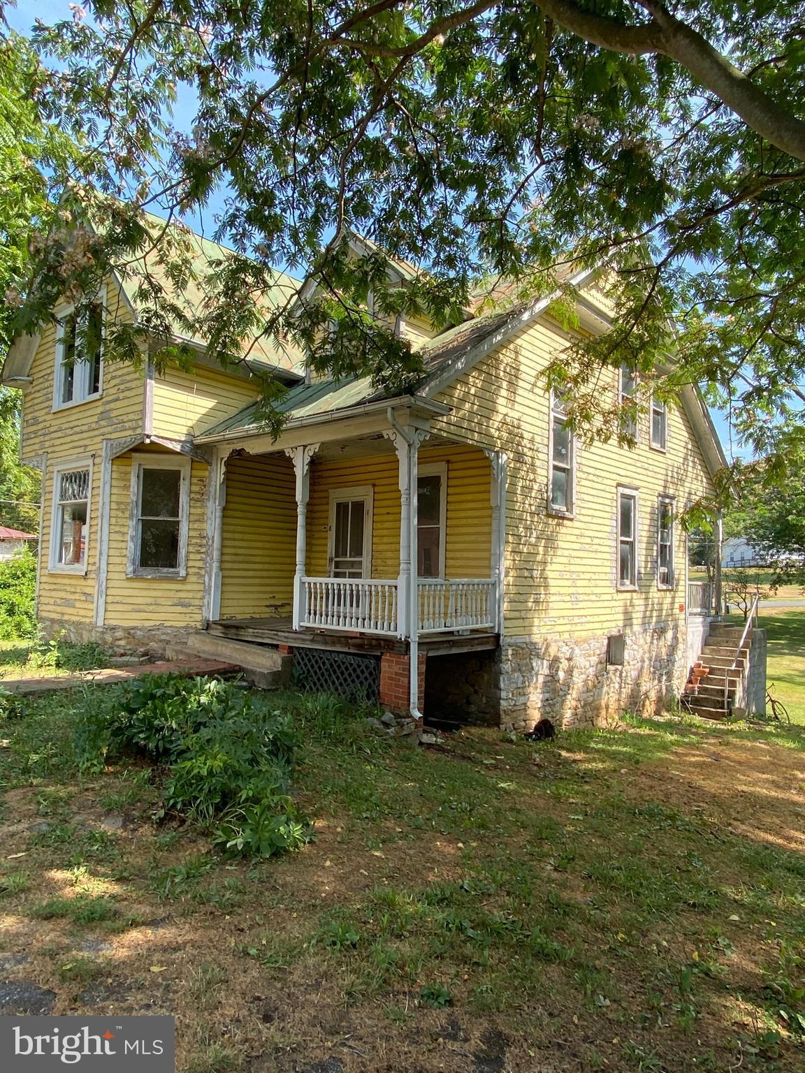 This Queen Ann style  home will prove to be a rewarding project.  The exterior graces front and side
