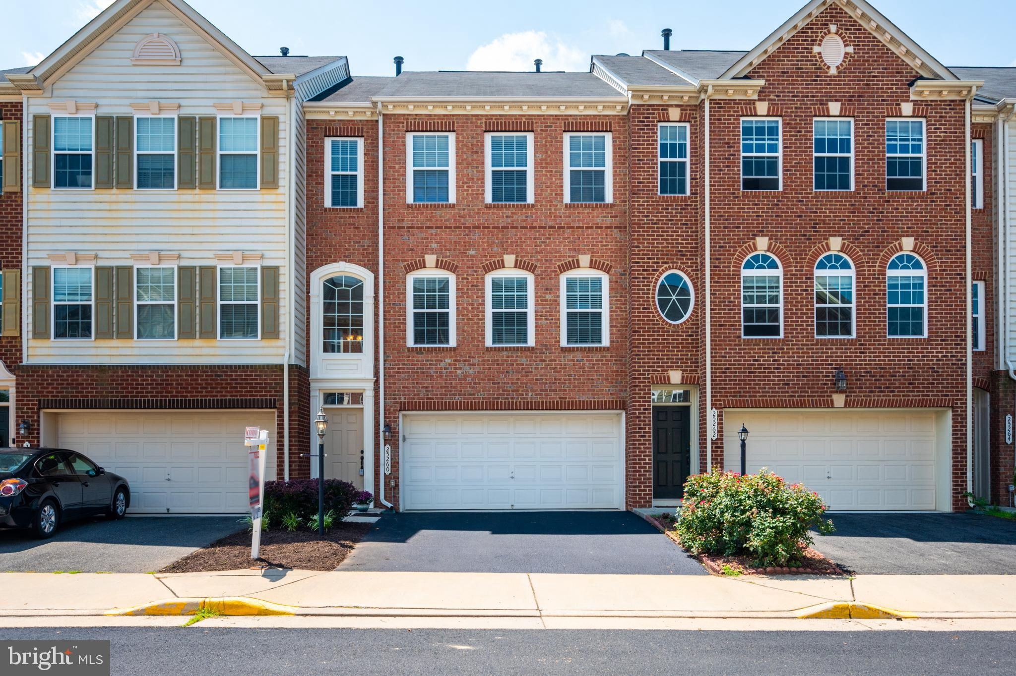 Shows like a model home!  3 Level garaged  brick front home .  Main level features gleaming hardwood