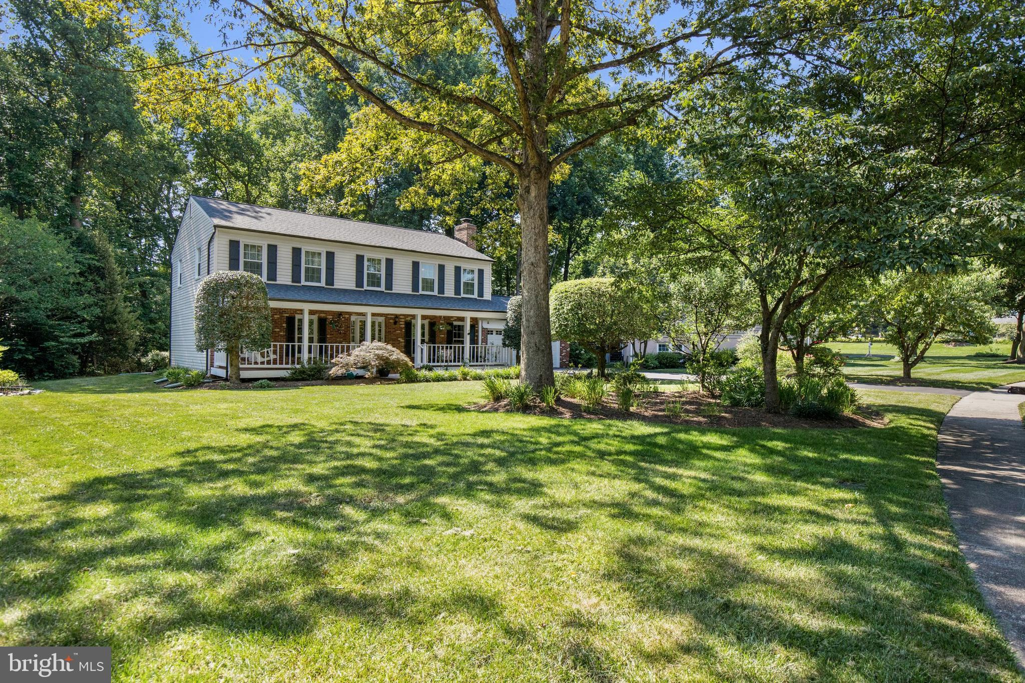 An inviting front porch welcomes you to this classic colonial on an over-sized cul-de-sac lot (.40 a