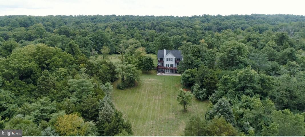Gorgeous setting with this classic 2 story colonial. Beautiful mountain views on 6 tranquil unrestri