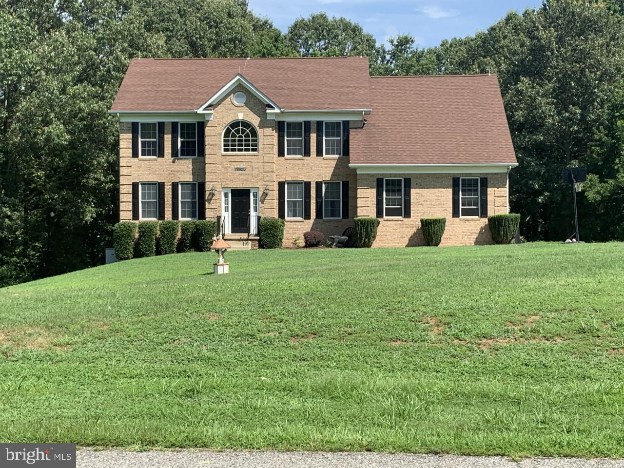 Beautiful Brick Front Colonial that sits on almost four acres!!! This home offers four bedrooms, thr