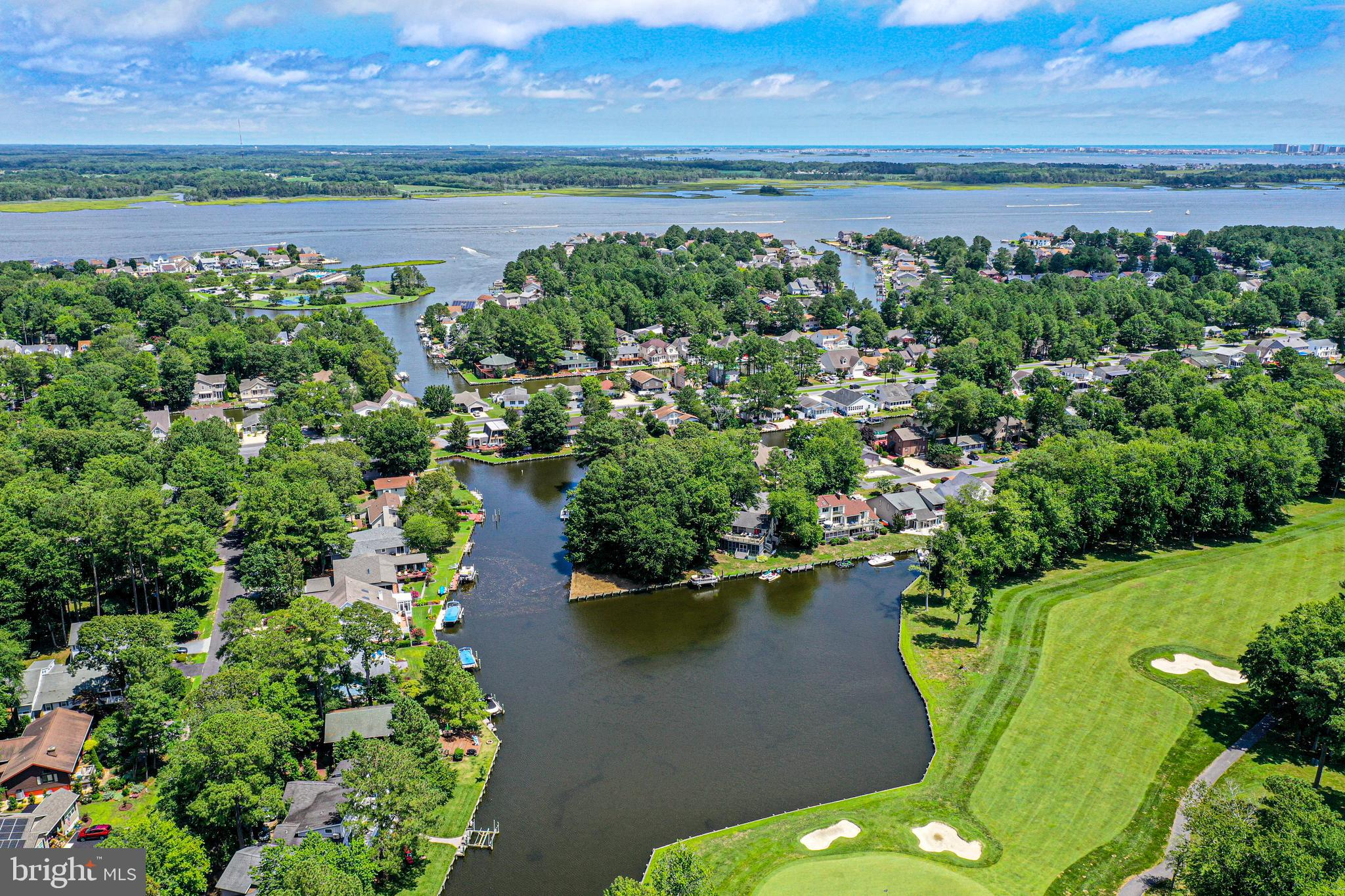 STOP, LOOK & LISTEN--One Of A Kind! Ultra-Large Wooded Waterfront Lot With Approx. 200 Feet Of Bulkhead That Offers Southern Exposure, Unobstructed, Panoramic Open View Of Large Lagoon, Fairways And Greens Of Golf Course. 1/2+ Acre With 31,597 Square Feet Including Riparian Rights Allowing One To Build The House Of Choice Located On A Cul De Sac Near The Country Club And Golf Course. Boating Is Minutes Away From Ocean City And Atlantic Ocean. This Is The Only Available  Wooded Waterfront Lot Of This Size With Unique And Ultimate Views .Shop And Compare!  Seller (Husband) Is Licensed To Sell Real Estate In The State Of  Maryland.