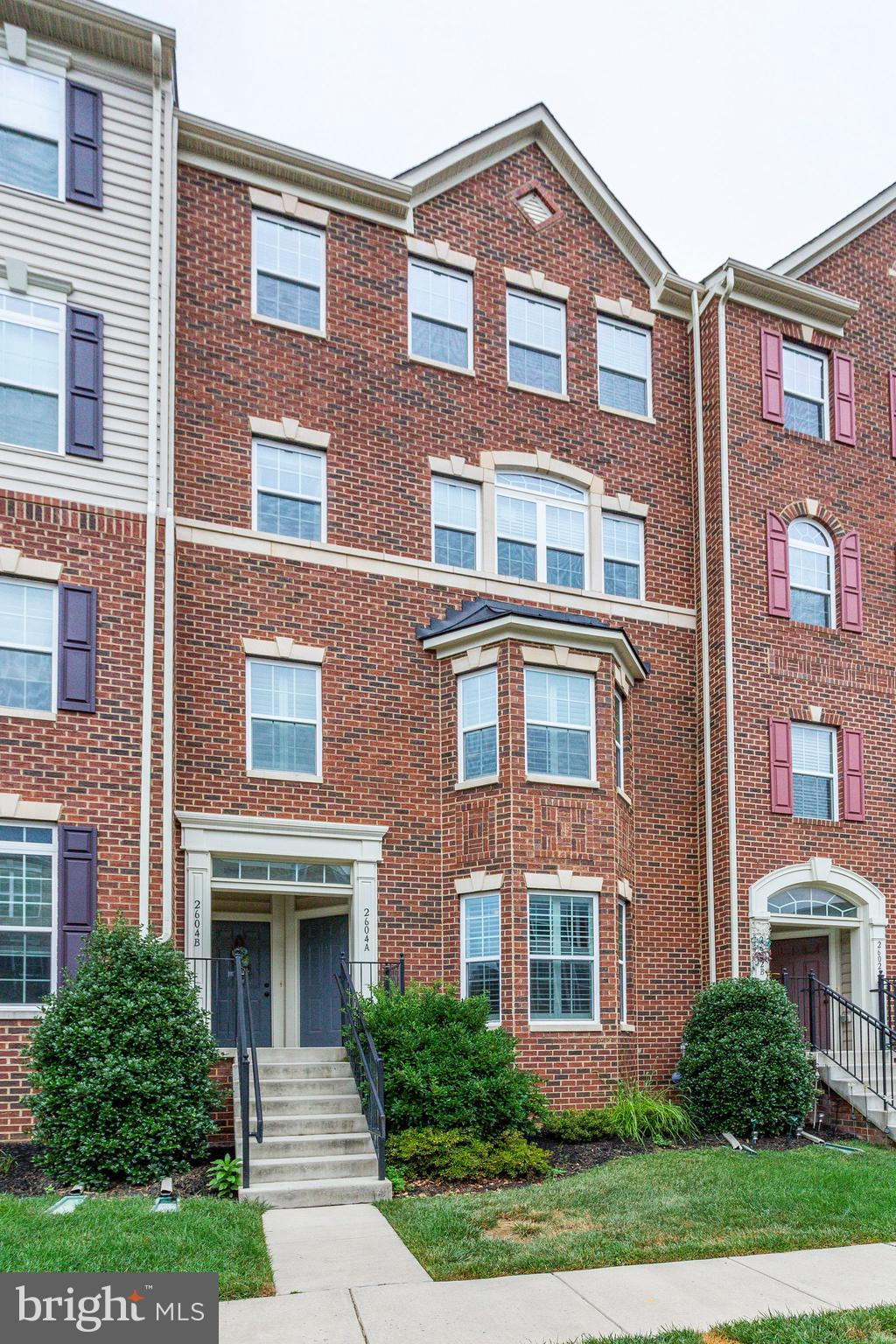 This gorgeous brick front condo is not only located in a prime location, it is move in ready with ab