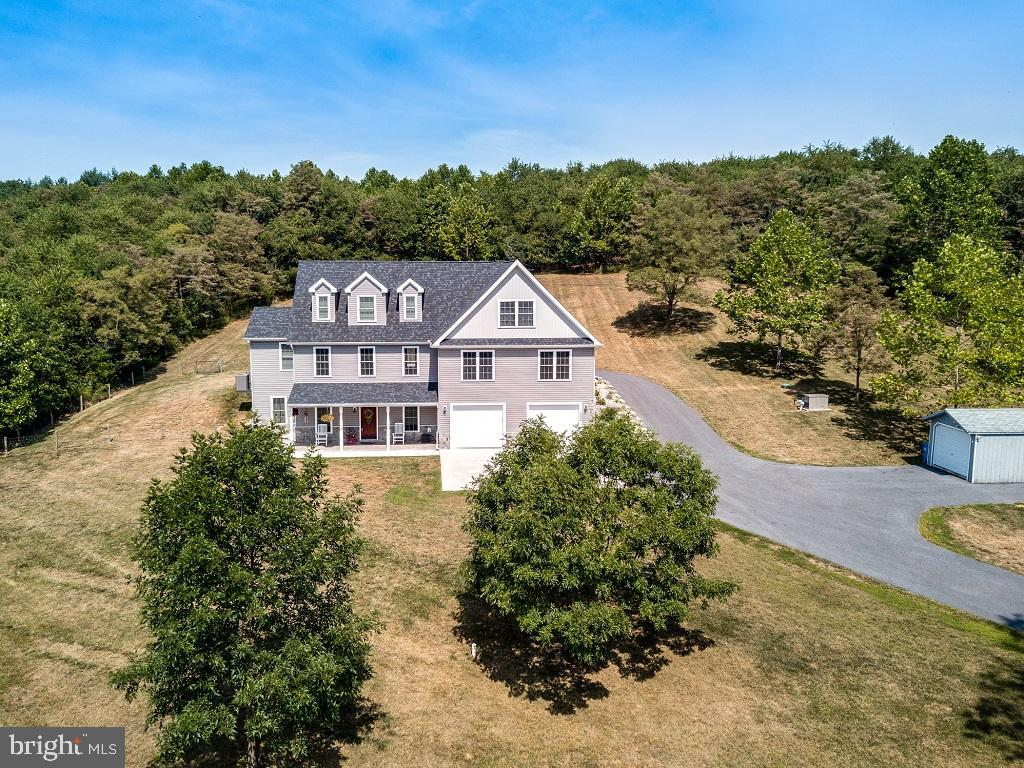 Amazing 5 Bedroom 3 Full 1 Half Bath colonial built in 2017 situated on 3.15 acres surrounded by far