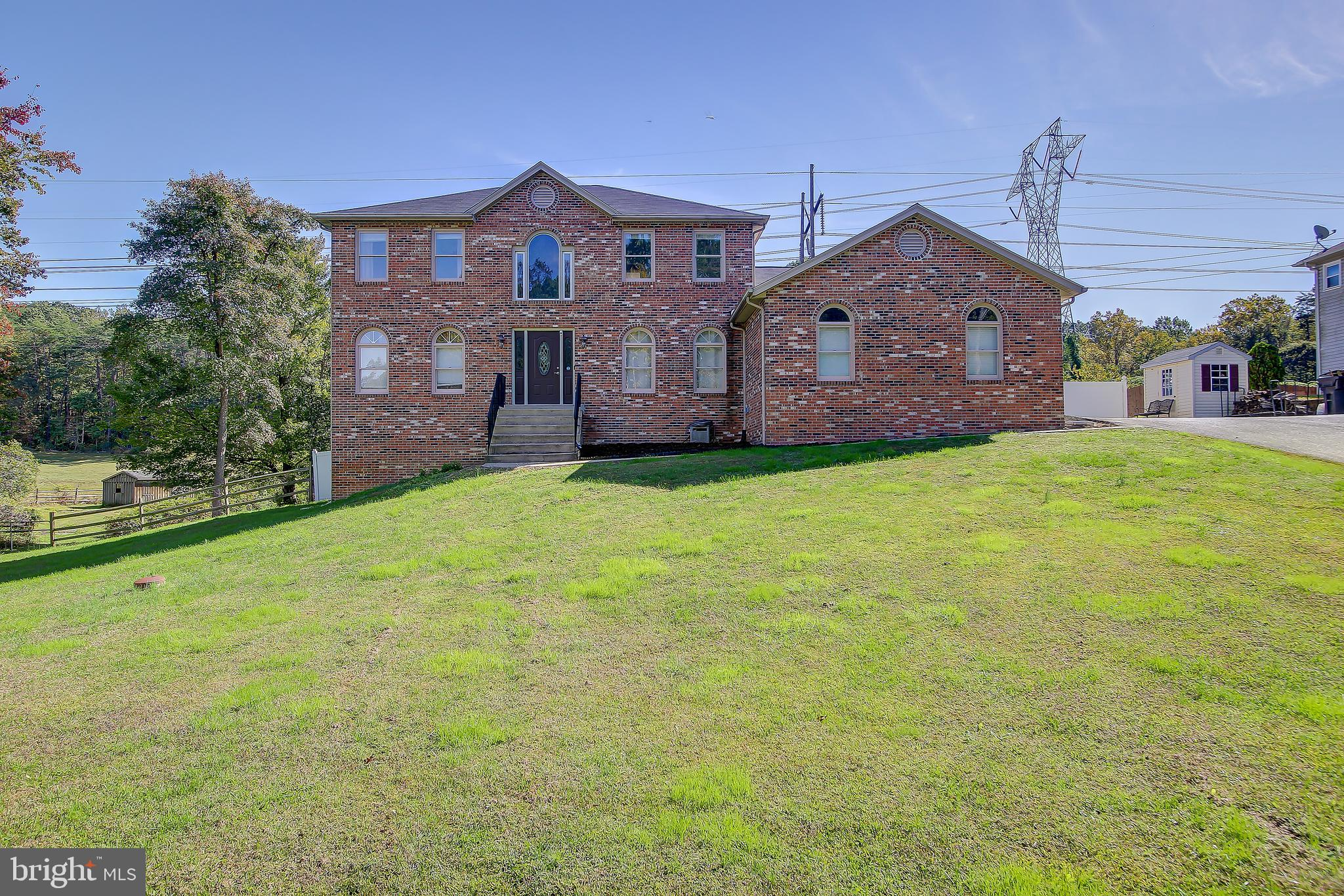 Don't miss this rare opportunity before it's gone! This beautiful 4 bedroom/3 bathroom brick front colonial has a lot of qualities you just won't see everyday in this market. Some of the more notable features include... Both HVAC systems were replaced in 2019, Heated inground pool, 1.46 acre lot backing to unbuildable land, 2 car side load garage while being located in a small neighborhood with a private feel and NO HOA yet still close to everything.  Upon entering the front door, you'll find a large two story foyer with beautiful hardwood floors. Just inside..  there is a convenient main level bedroom with a full bathroom perfect for guests or a family member who wants to avoid stairs. The open kitchen with its cherry cabinets, Corian countertops, tile flooring and island is just off of the good sized family room with vaulted ceilings, skylights and a wood burning fireplace. Direct access from the family room to the rear deck overlooking the beautiful heated pool, patio and fenced in yard; makes it the perfect location for get togethers or just relaxing evenings with the family. The main level also offers a formal dining room with a large bay window with no shortage of natural light and a formal living room that could be used as an office. The upper level has tons of natural light with its Palladian window located above the foyer and skylights in both bathrooms. Your spacious owner's bedroom with a walk-in closet and large owner's bath boasts a floor to ceiling tile shower and huge soaking tub. Also on the upper level you'll find two additional great sized bedrooms and another full bathroom. The entire upper level carpet including the stairs has been replaced and fresh paint in most areas. The large basement is framed and ready for drywall, but it could easily be re-designed to meet your family's specific needs or desires. Some possible options could include a 5th bedroom meeting code requirements with a window already in place, a large recreation room, theater room or even an in-law suite. Or.. you could generate monthly cash flow and lower your mortgage obligation by utilizing the separate side entrance to basements for tenants.   All of this while still being only minutes away from I-95 access, close to commuter lots, VRE, shopping, dining options and the Hospital is a rare opportunity! Open house is scheduled for 11am-3pm on Sunday 10/18/20.