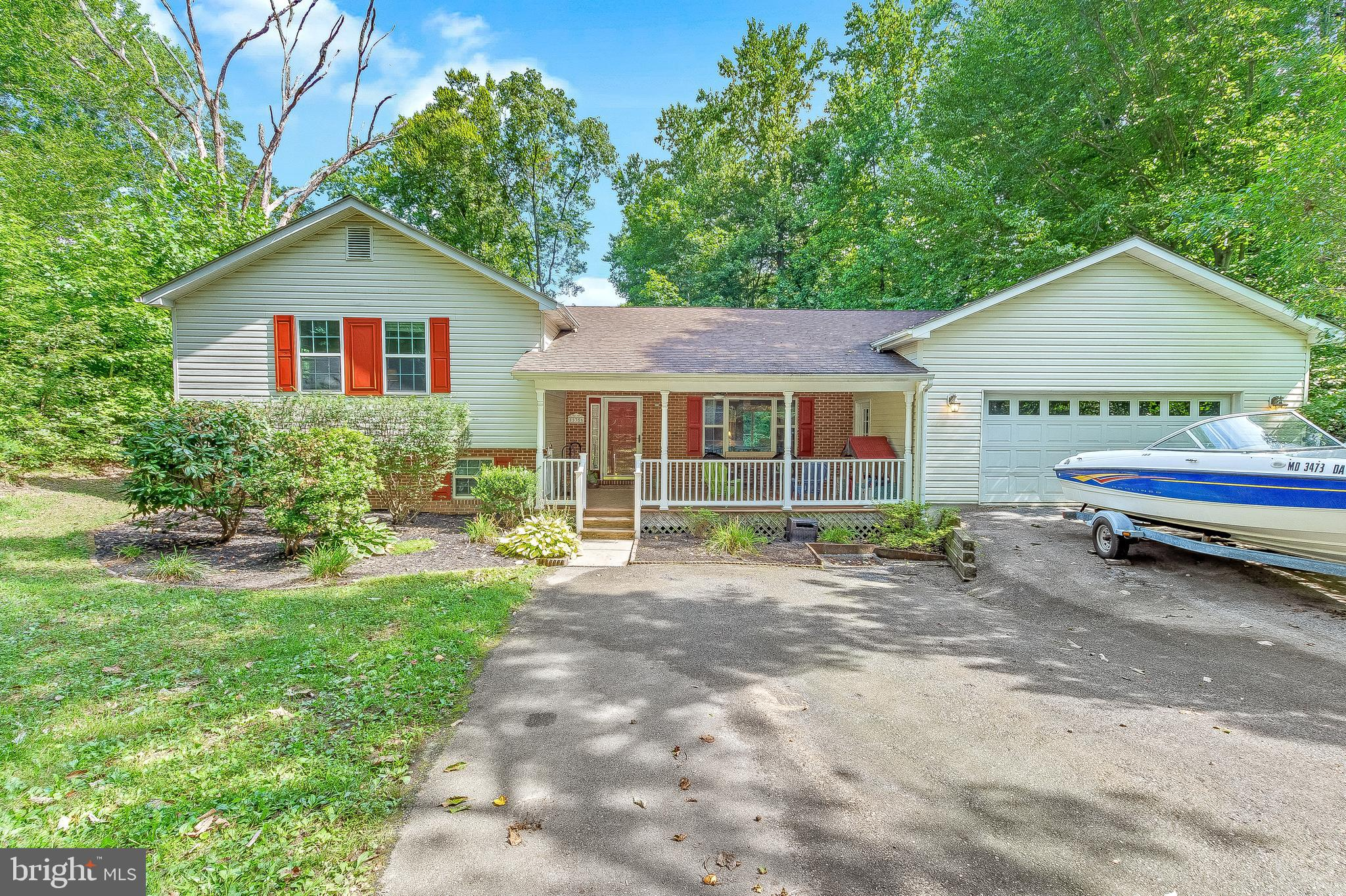 Spacious split level home on quiet cul de sac checks all the boxes!  Covered front porch is deep eno