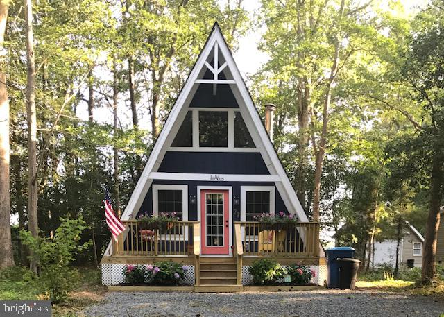ATTENTION REAL ESTATE INVESTORS. Do you want a vacation property that will pay you a 10% return? This A-frame is a must-see.Tucked just inside Ocean Pines' North Gate, you'll find a fully renovated (in 2017) A-frame that any HGTV fan will appreciate. This 2 Bedroom, 1.5 Bath house offers charming living space and an open Loft area for extra guests. Renovations include new plumbing and electrical, new windows, and a beautifully detailed Kitchen with new appliances. Enjoy the open living concept on the lower level, enhanced with solid hardwood flooring and custom blinds, or step out back and lounge on the new rear deck. You'll find a storage Shed that matches the home in the backyard. Duct work within the home has recently been cleaned and HVAC is serviced every 6 months. Seller is offering a 1-year Home Warranty by Cinch with an acceptable offer. ANNUAL RENTAL INCOME FOR THIS PROPERTY AVERAGES $25k-$28k. Property is being sold - AS IS .