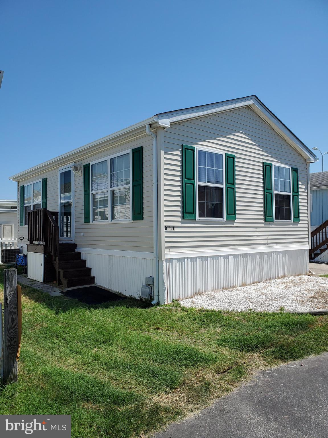 In the Heart of Ocean City!  This home is 2 Blocks from the Boardwalk located in this well kept Waterfront Community.   Low Association Fees which includes Water, sewer & trash, and  low settlement cost.  Possible Owner Financing with acceptable credit.  This Beach Cottage features Open Floor plan with one bedroom & one Full Bath and a great layout,  Great Condition and sleeps 6.   Don't delay call today!