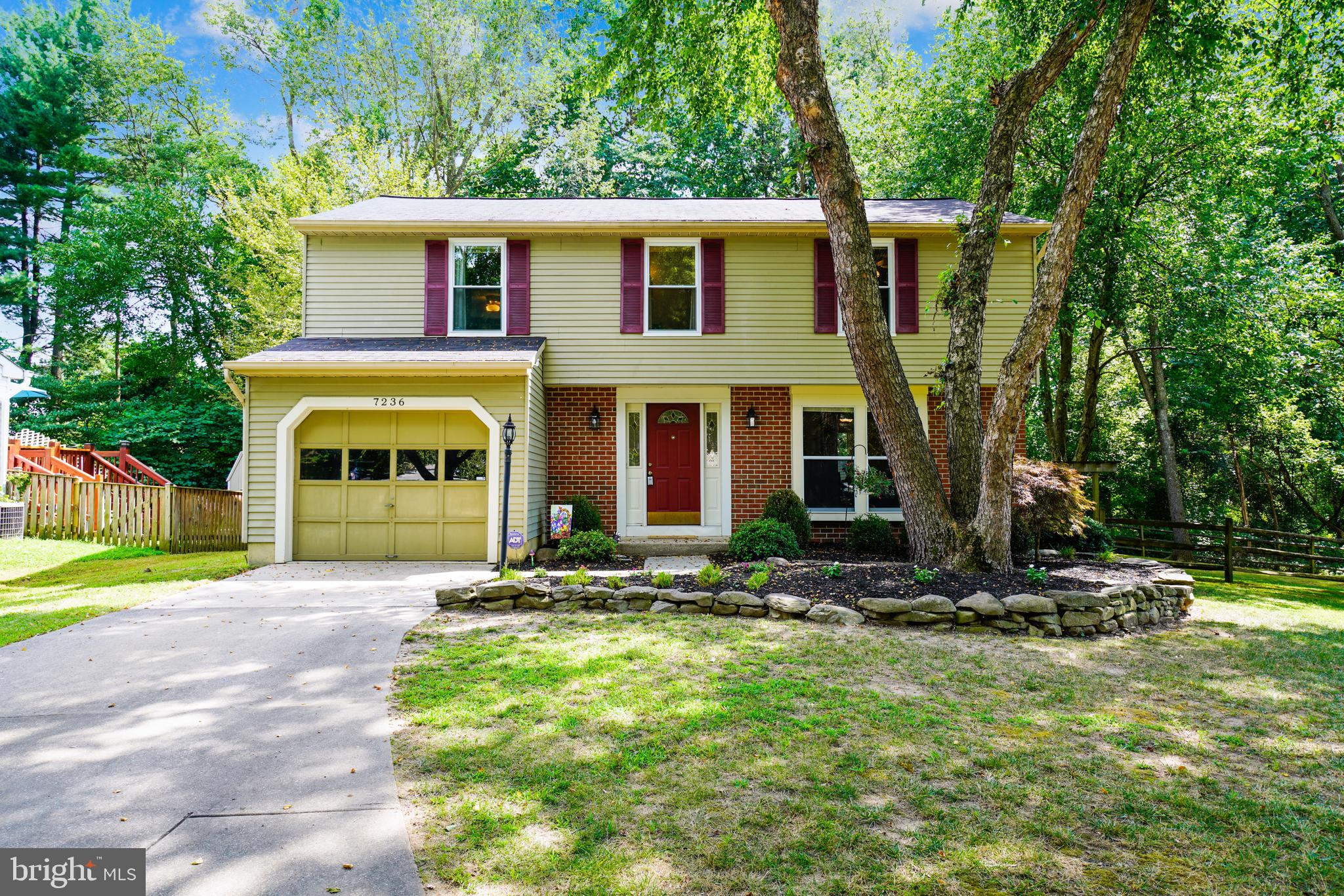 Charming updated  4 Bedroom Colonial at the end of the Cul-de-Sac.   Warm Brazilian Cherry hardwood
