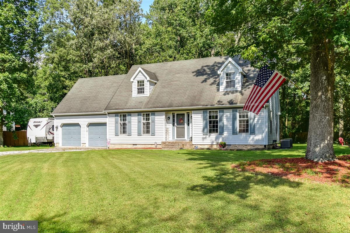Charming Cape Cod on over half an acre lot! This 4-bedroom,  2-bath home with 2-car garage is locate