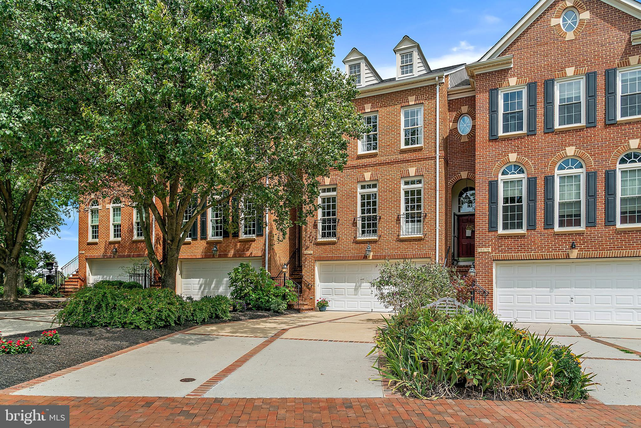 NEW PRICE!!   Welcome Home to 18474 Perdido Bay Ter, Leesburg VA in River Creek.  This Perfect, Light-filled, Brick Front Town Home with 3 Bedrooms, 3.5 Bathrooms, 2,600 Sq. Ft Finished Living Space on 3 Levels, 2 Car Garage, Deck, Walkout Basement, & Fully Fenced Yard in the Prestigious Gated River Creek Neighborhood! This Home is Perfectly located with Year Round Views of the Potomac River, Brand New Professionally Designed Kitchen with Granite Countertops, Lighted Cabinetry with Antique Crackle Glass Facings, Hue Recessed Lighting, Custom Walk-In Closets, Built In Cabinetry in both Main and Lower Level Family Rooms with Crafted Stained Glass Doors.  This Gorgeous Townhome has Been Recently Professionally Painted, Provides an Open & Spacious Floor Plan with Hardwood Floors & Crown Molding! Plenty of Room to Entertain in the Inviting Gourmet Kitchen Complete with Center Island, Updated Stainless Steel GE Cafe Appliances, New Cabinetry, Granite Countertops, Double Ovens, & Eat-in Kitchen Space! Elegant Owners Bedroom Suite with Tray Ceiling with Lighting, Large Owners Bathroom with Dual Vanities, Jacuzzi Jetted Tub & Shower.  Total of 3 Bedrooms, 2 Full Bathrooms on the Upper Level with Laundry Room.  Fully Finished Walkout Basement with Full Bathroom, Natural Light, Fireplace & Premium Fenced Back Yard!  This Home is Move-In Ready and a Must See!  Enjoy All River Creek Has to Offer that Includes:  Golf, Swimming Pool, Fitness Center, Marina, Tot Lots Playground, Jogging Paths, Potomac River Access & More! Gated Secure Community!  This Home is Conveniently Located to Nearby Shopping, Leesburg Outlets, Restaurants, and an Easy Commute to Northern Virginia, Maryland, and Washington DC.