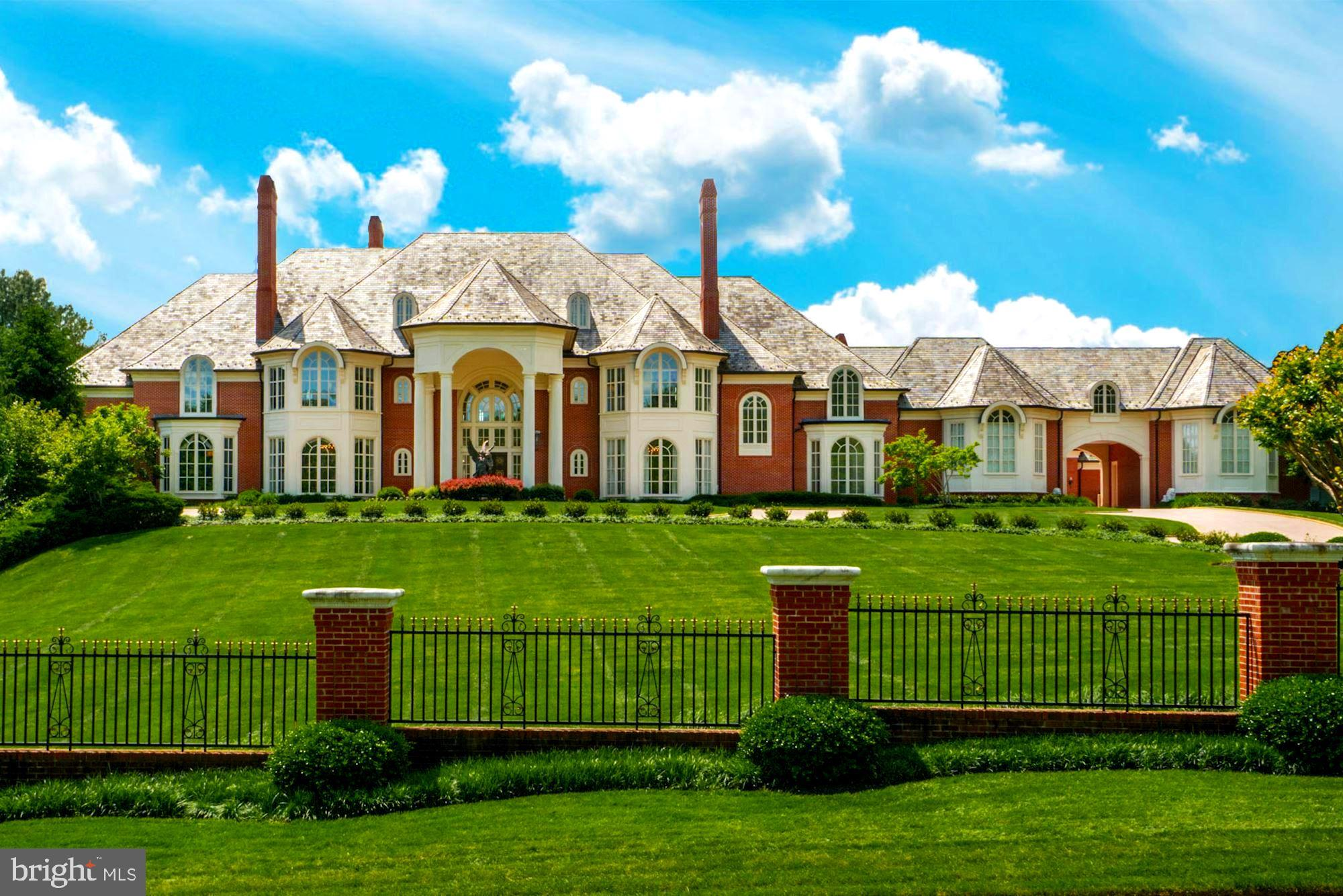 Exquisite gated 25,000 square foot brick mansion within comparable attention to detail in the exclus