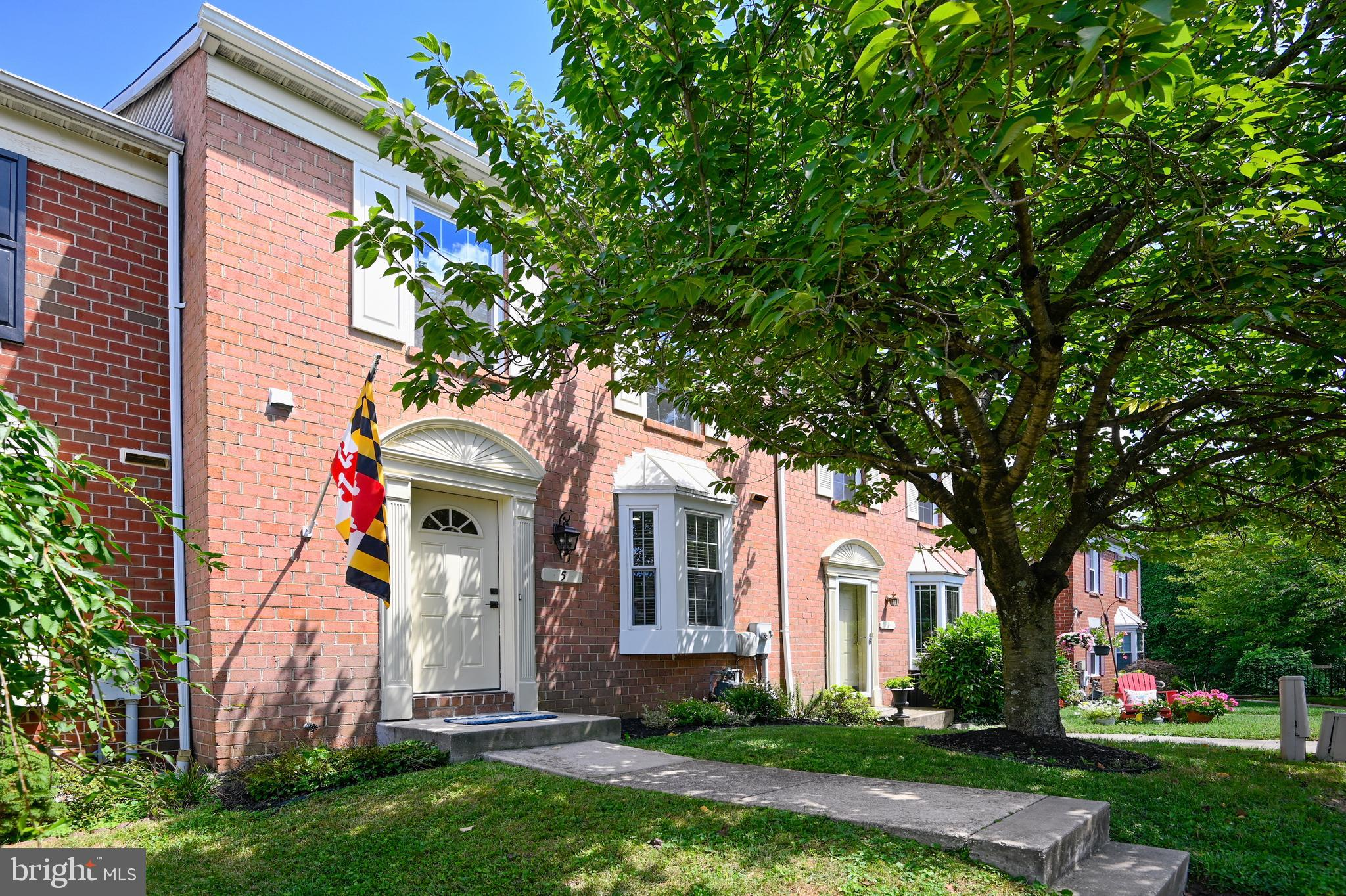 Impeccably maintained, modernized and ideally located three level townhome.   Bright, bay-windowed kitchen featuring white shaker cabinets with stone tops and stainless appliances.  Pass-thru looks onto an open dining and living room concept with updated flooring, and accented with a reclaimed wood feature wall.  Elevated deck off the living room is accessed through recently replaced glass doors.  Three bedrooms occupy the top level, highlighted by a large vaulted ceiling Master Suite, with walk-in closet and dual-sink bathroom.  Recently installed laminated double-pane windows also can be found on the entire floor.  Lower level walkout has an inviting family room, replacement floors and glass door, fireplace with an architecturally interesting mantel, full bathroom, office/exercise room and laundry w/front load washer-dryer.  Family room opens to a paver-stoned patio and landscaped rear yard enclosed by a 6' privacy fence.  WiFi enabled NEST thermostat system controls the home's heating and new AC unit (spring 2020).  The home neighbors Lake Roland Park and its ample outdoor activities - a true feeling of living in the country.  Minutes from the beltway and downtown.  This is the one for you!  See Virtual Tour for Interactive Floor Plan.