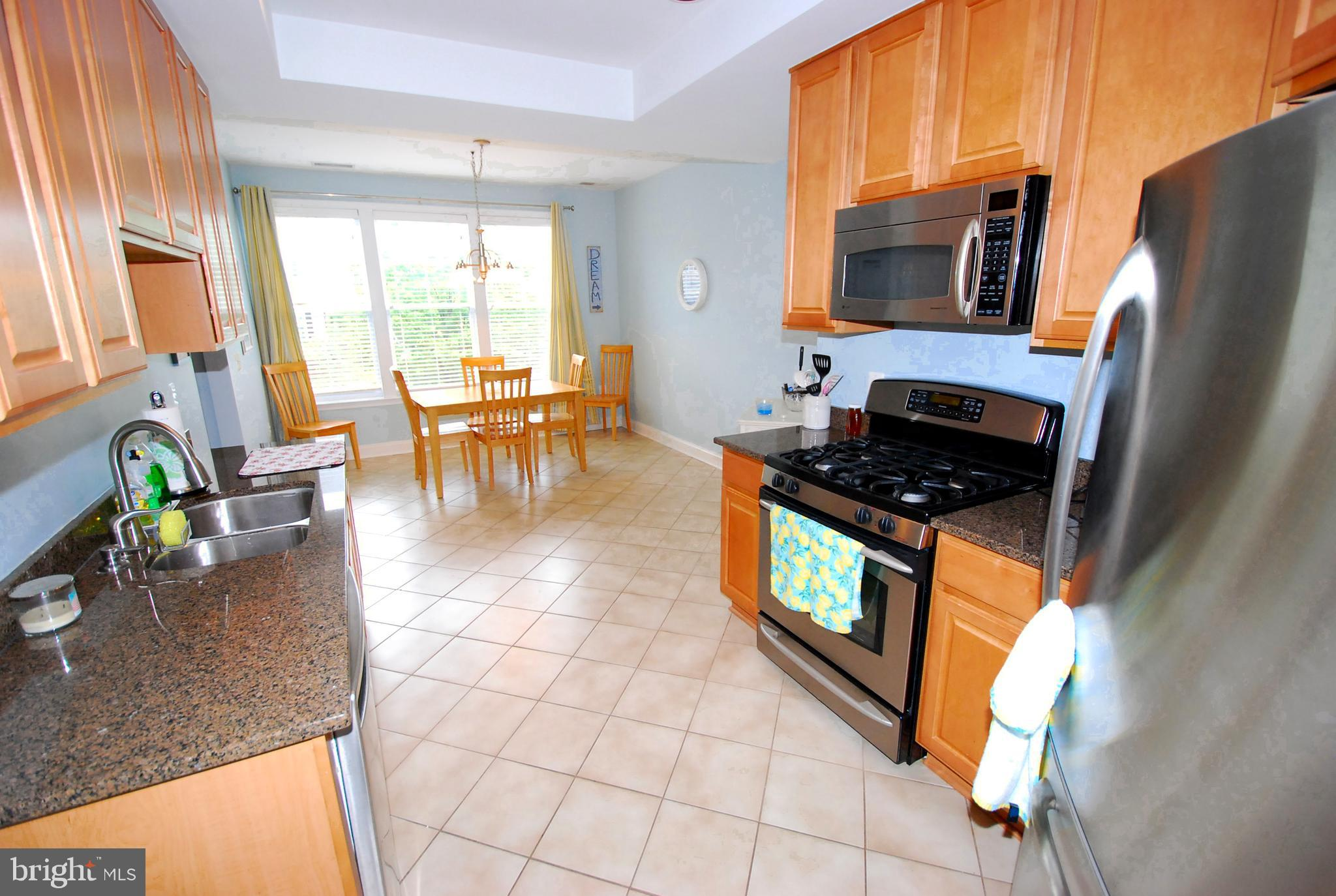 Rare opportunity!  This beautiful and light filled 2 bedroom 2 bath condo has an ELEVATOR!  Enter in