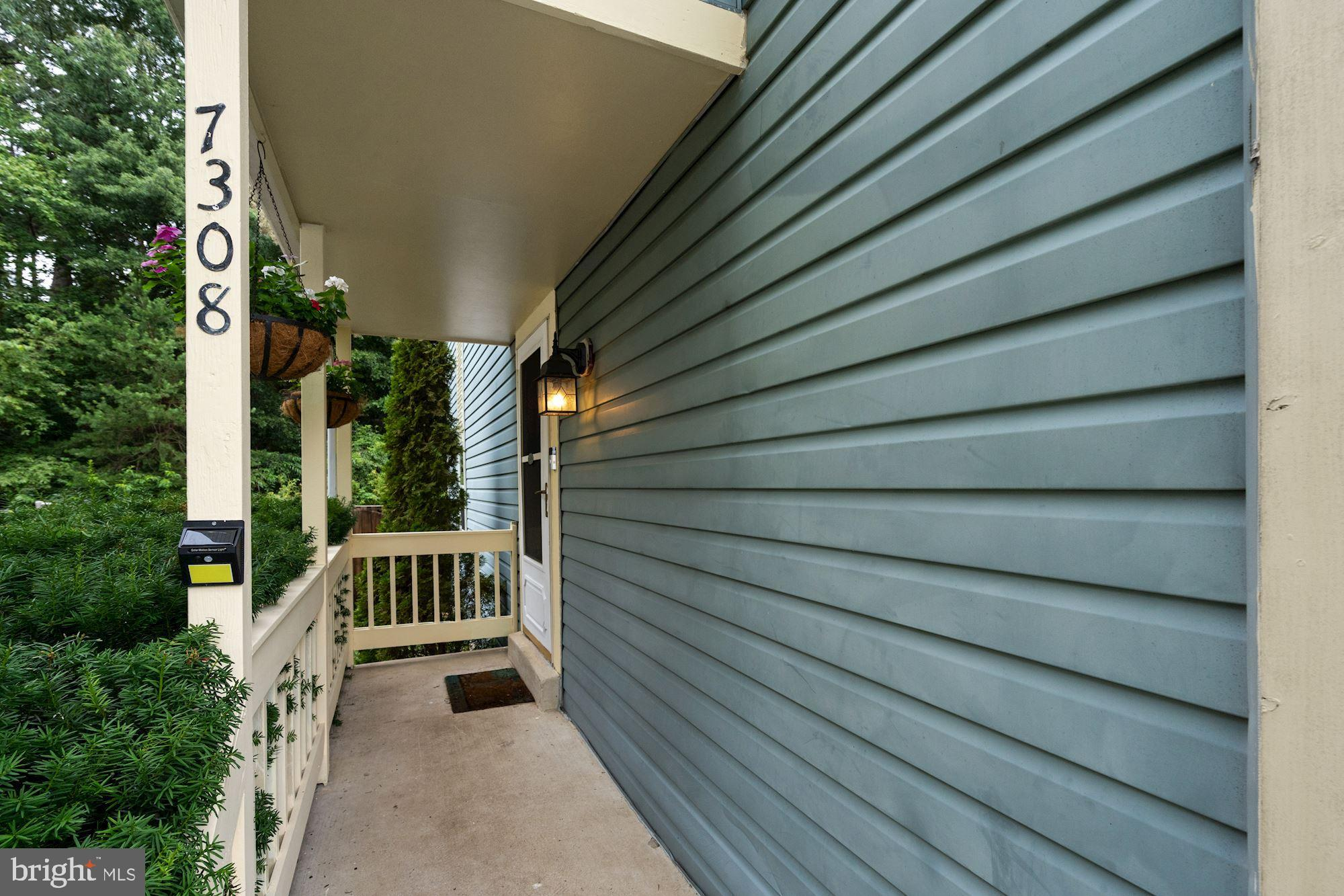 Lovely end unit townhouse in desirable Kingstowne! The inviting porch welcomes you in. Hardwoods on