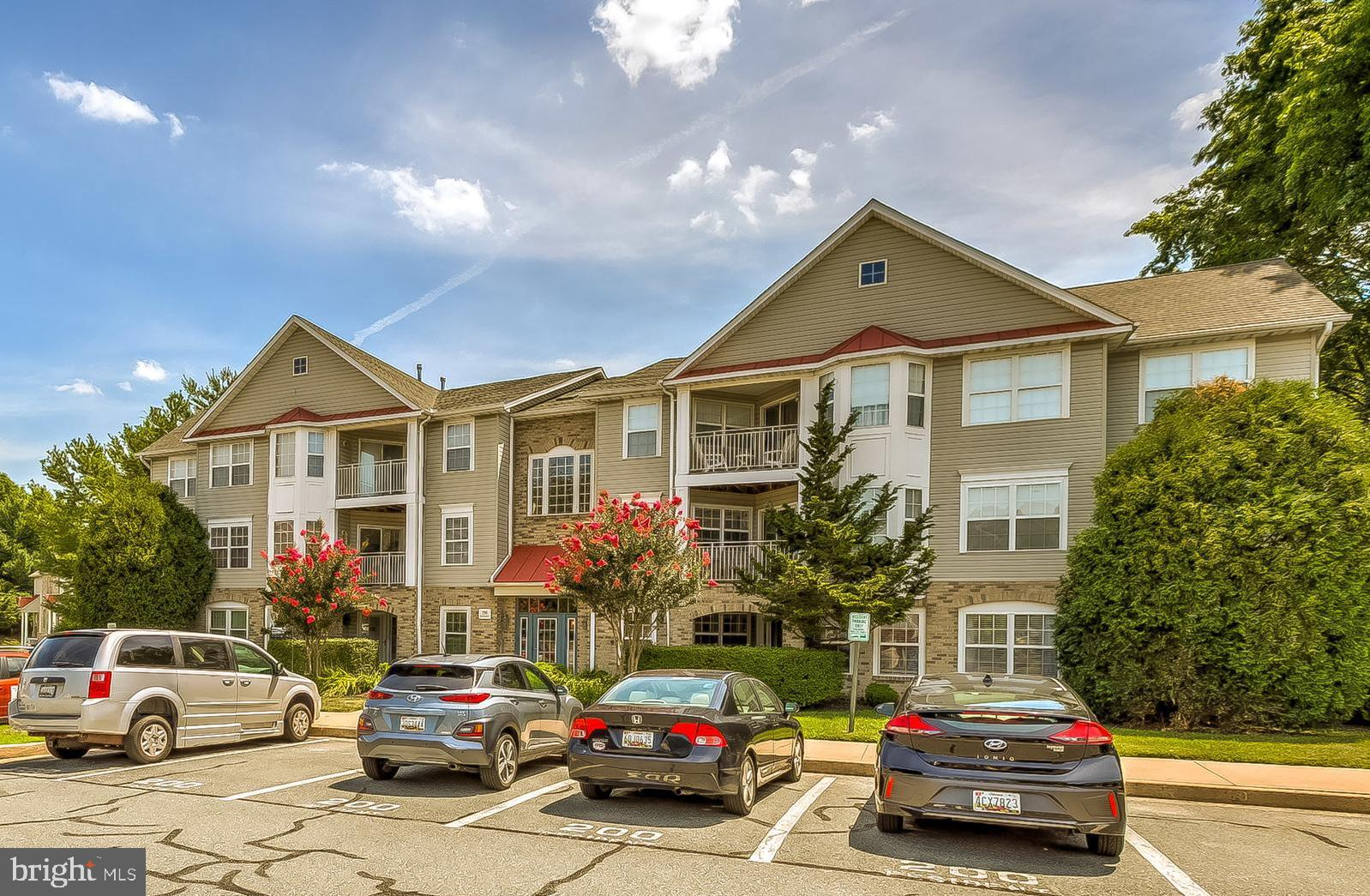 Nestled in a quiet court in prestigious Spenceola Farms, this 2nd floor ELEVATOR CONDO is absolutely