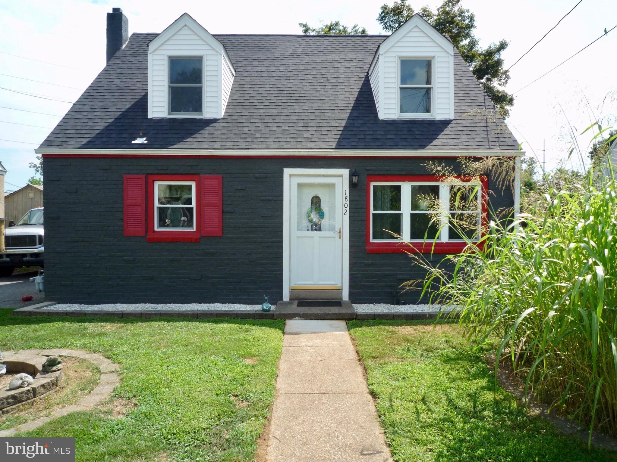 WOW! This brick front exterior 4br/2.5ba Cape w/ a detached 2 car garage at the rear has loads of up