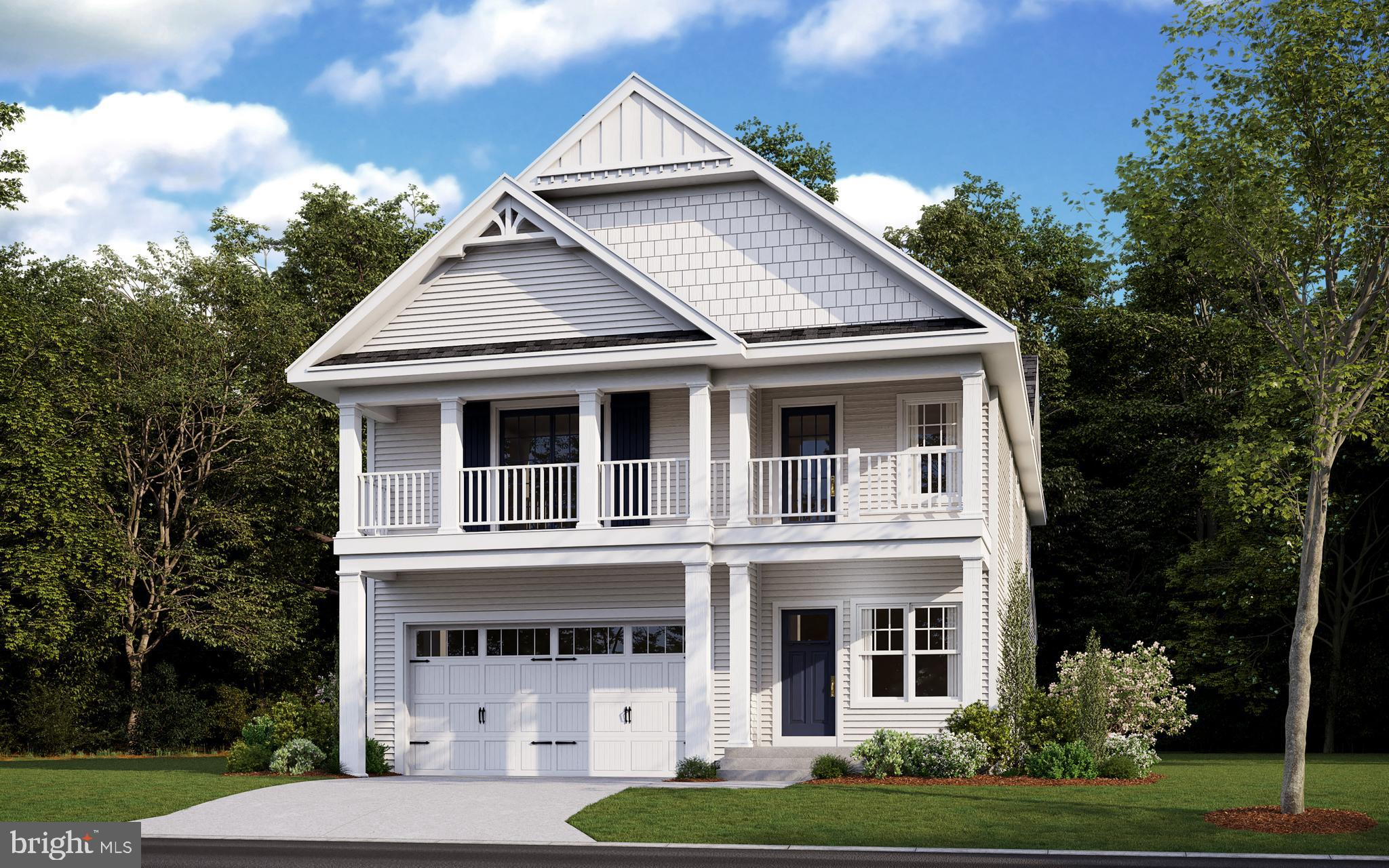 The Charleston, by Bryton Homes, flaunts its irresistible curb appeal, highlighting first and second