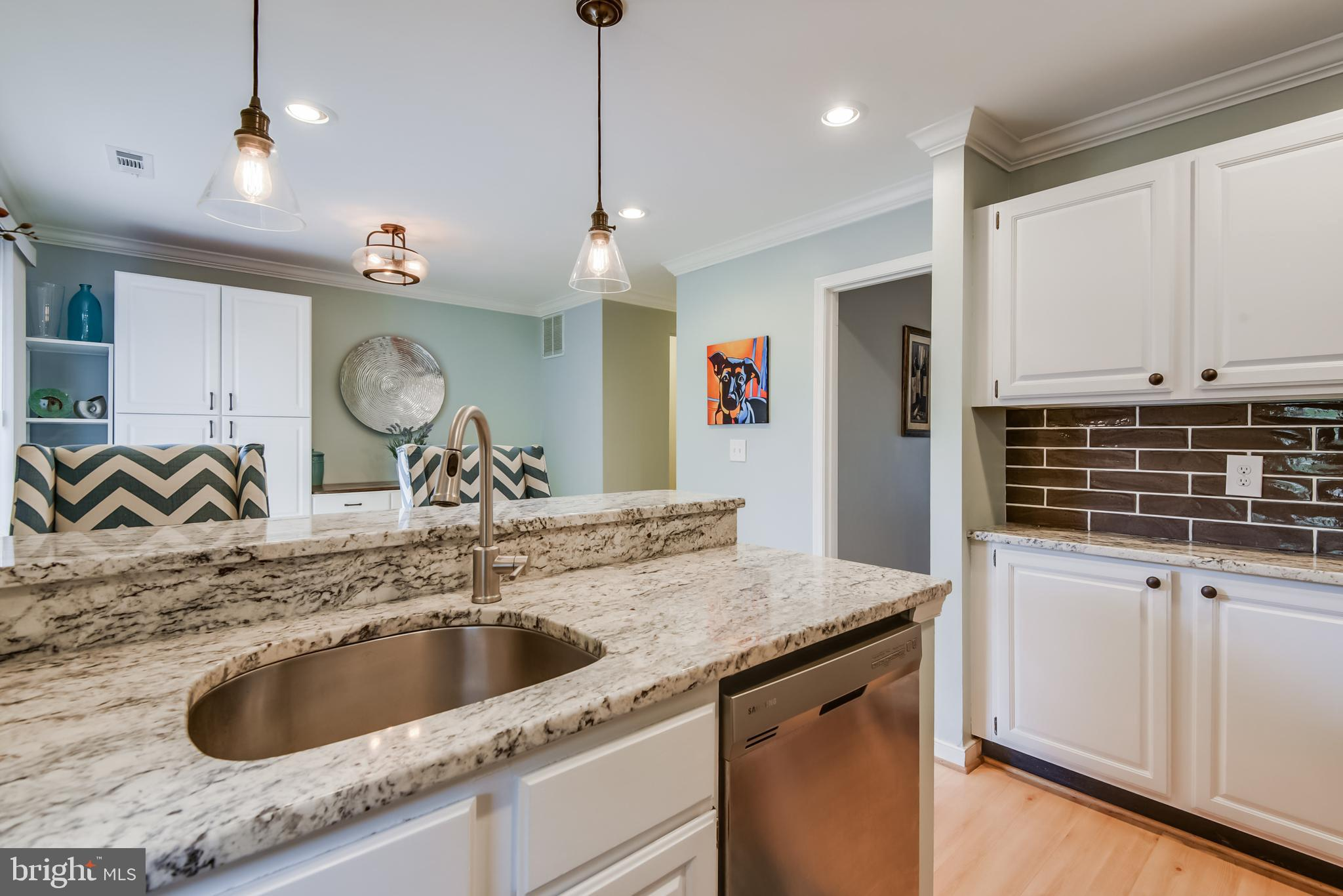 From the moment you enter your updated 3-LEVEL townhome  you will notice the updated spaces and mode