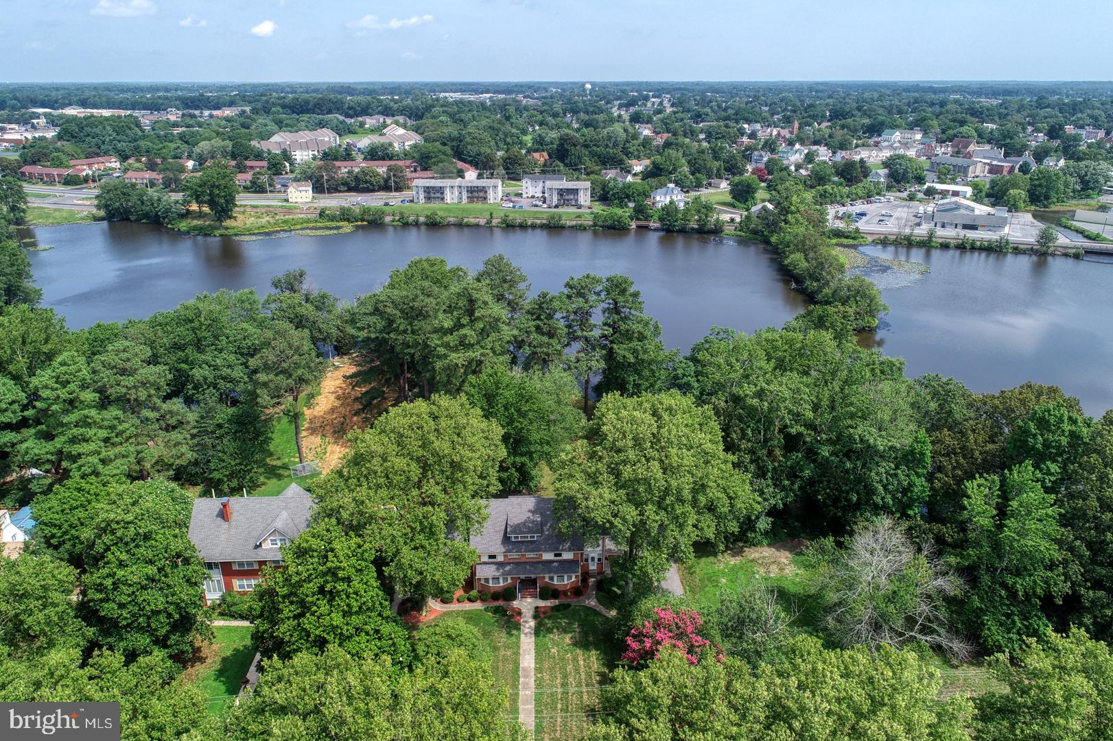 Beautiful LAKE FRONT Turn of the Century Colonial! Become part of Milford's history on this 1 acre w