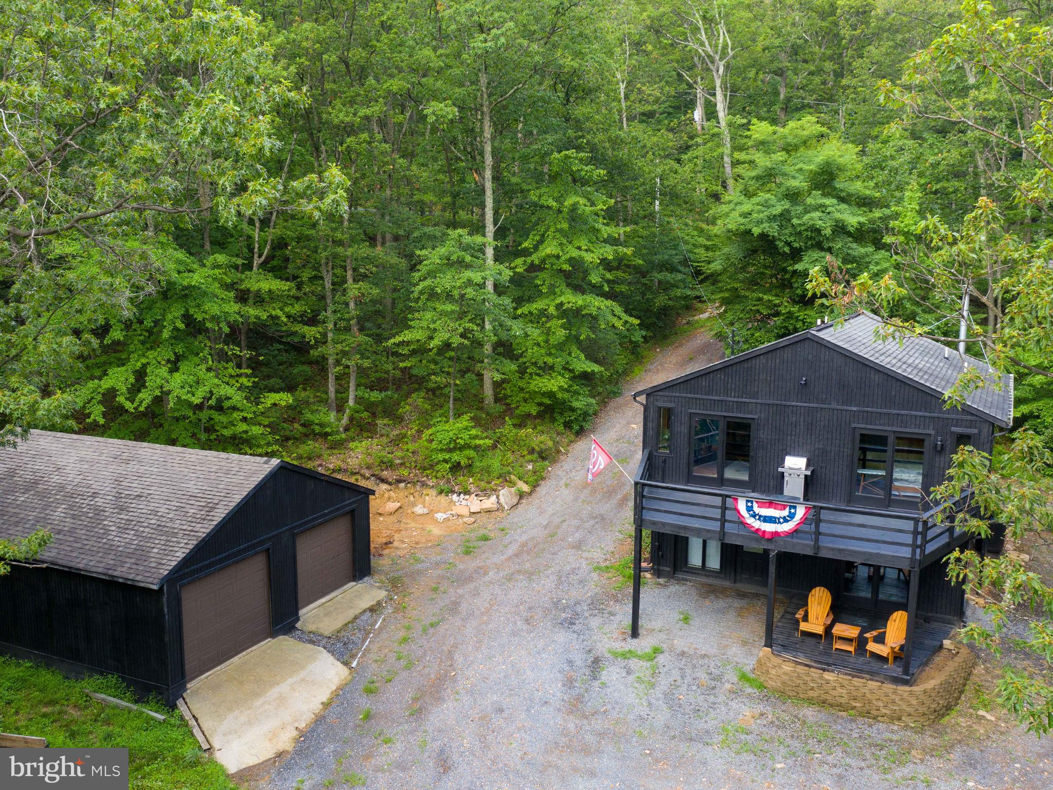 Mountain views with relaxation awaiting on the large 12x28 deck accessible from the living room and