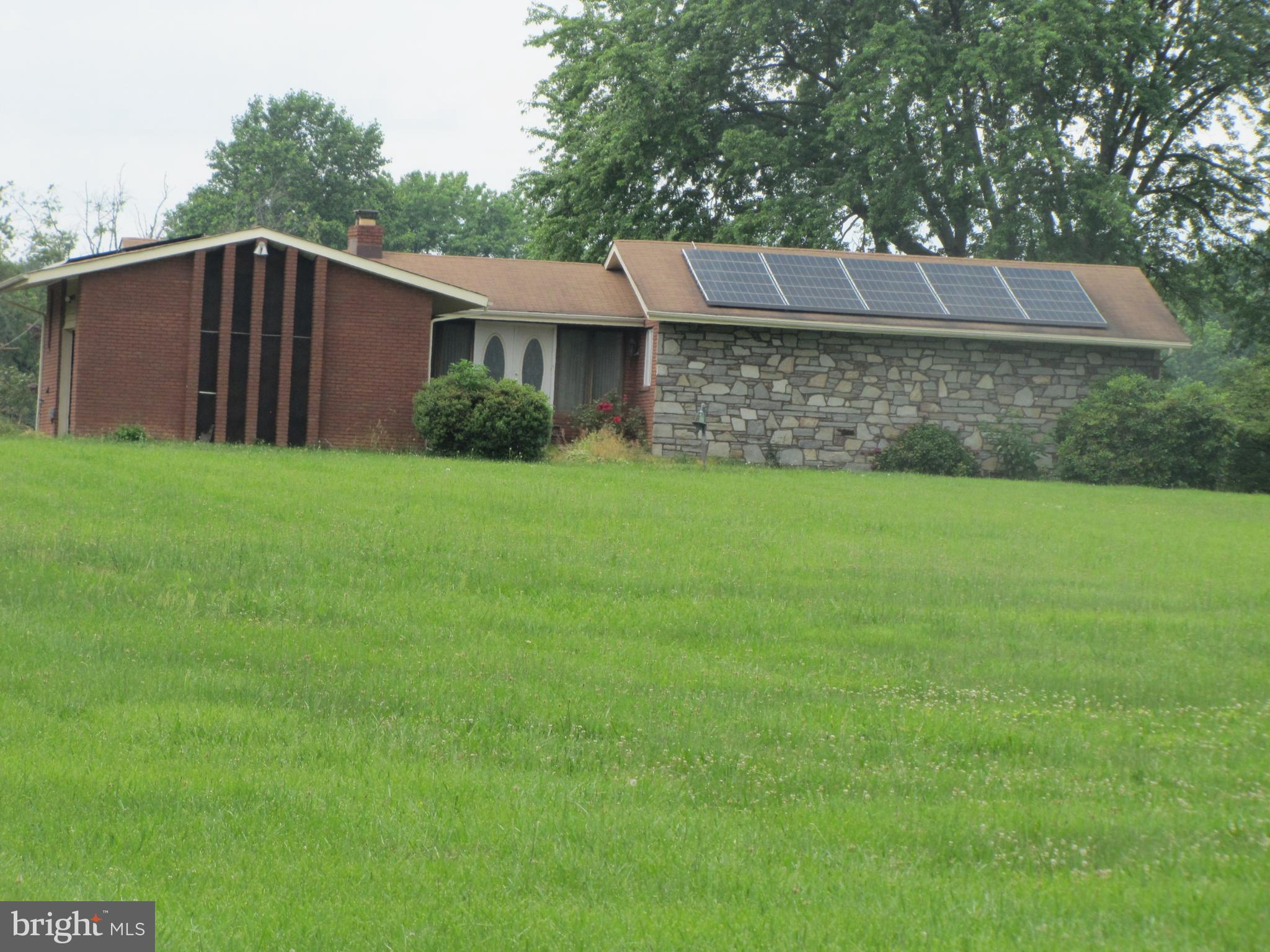 AS IS Sale.  Needs TLC.  Very private and comfortable area. Lot has  2 separate septic systems, Bulk