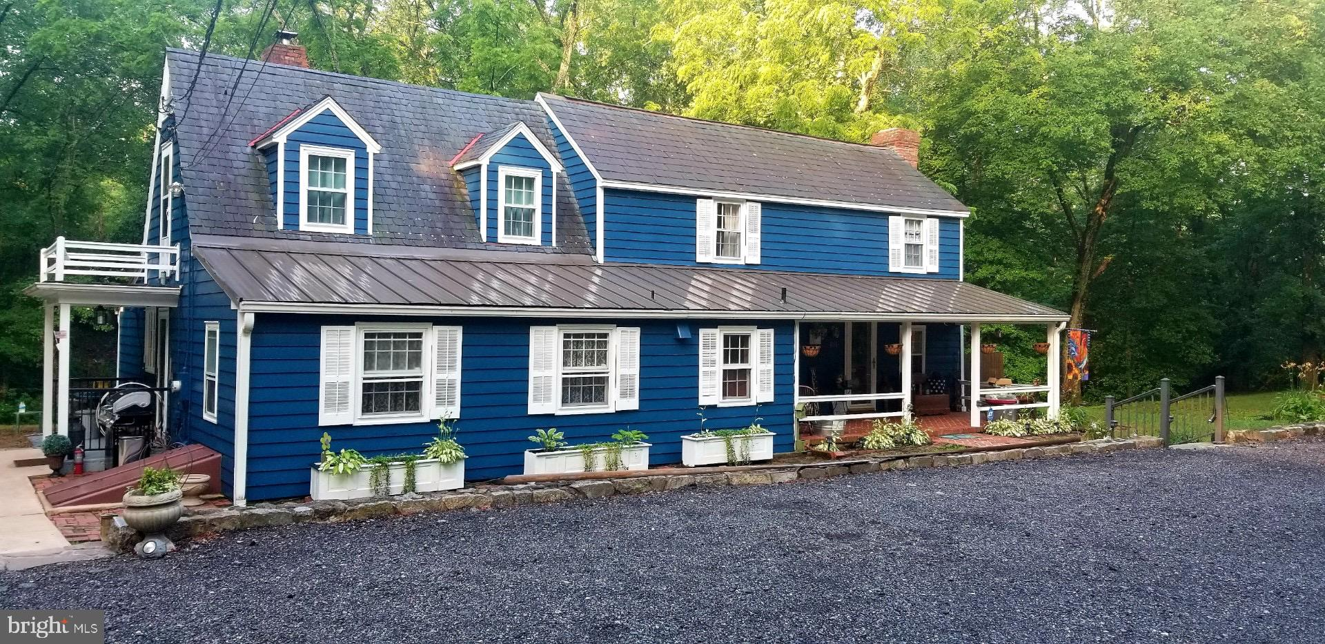 Gorgeous property with over 9.4  private acres with stream.   This is a outdoors mens  paradise .  C