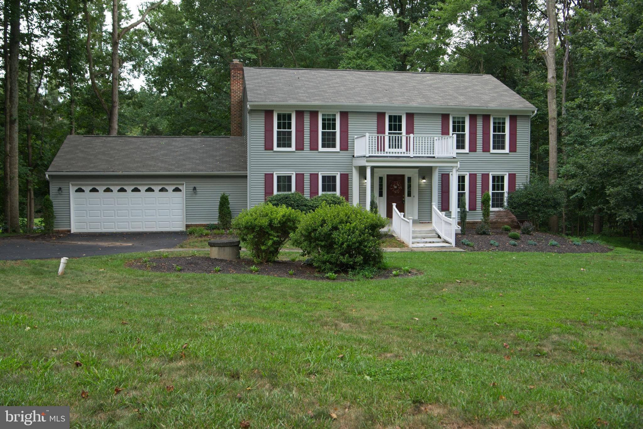 A true find!!  Large, stately 4-bedroom, 2.5 bath colonial on a quiet street in the highly desirable