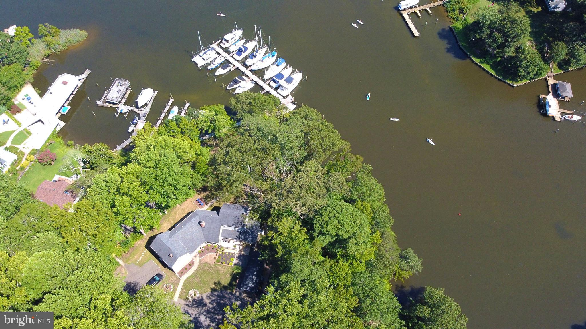 Rare opportunity to own this private, boutique marina with 23 deep water slips updated residence and