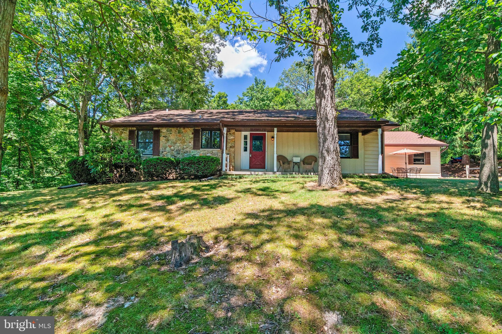 Beautifully updated 3 BR 2.5 BA Rancher in a private wooded setting. Stainless steel appliances, gra