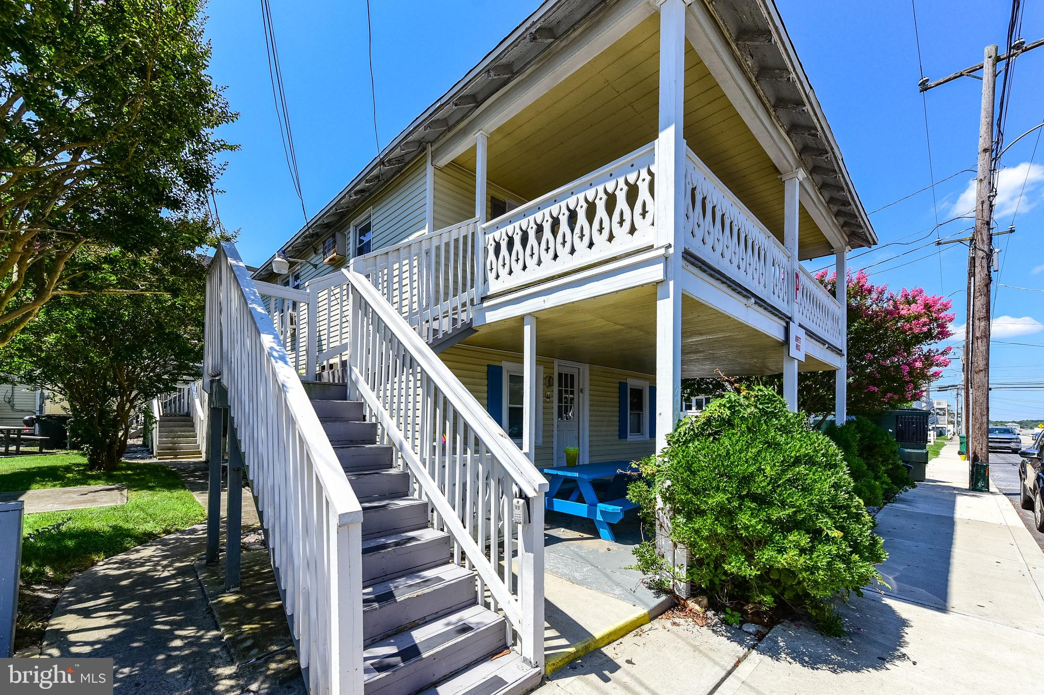 Large 3 Bedroom, 2 Bath   in the Parrot Bay Condo Association, Pool, Parking, 2 Blocks from the Boardwalk, Located on the Second Floor,  Huge Covered Front Porch is Perfect for Summer Evenings and Crab Feasts,  Super Clean Unit in very good condition, Outstanding Rental Potential,