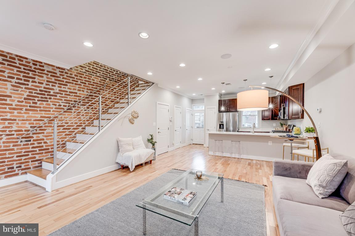 Situated on one of the prettiest, gingko-lined blocks in Columbia Heights this 1911 Wardman row hous