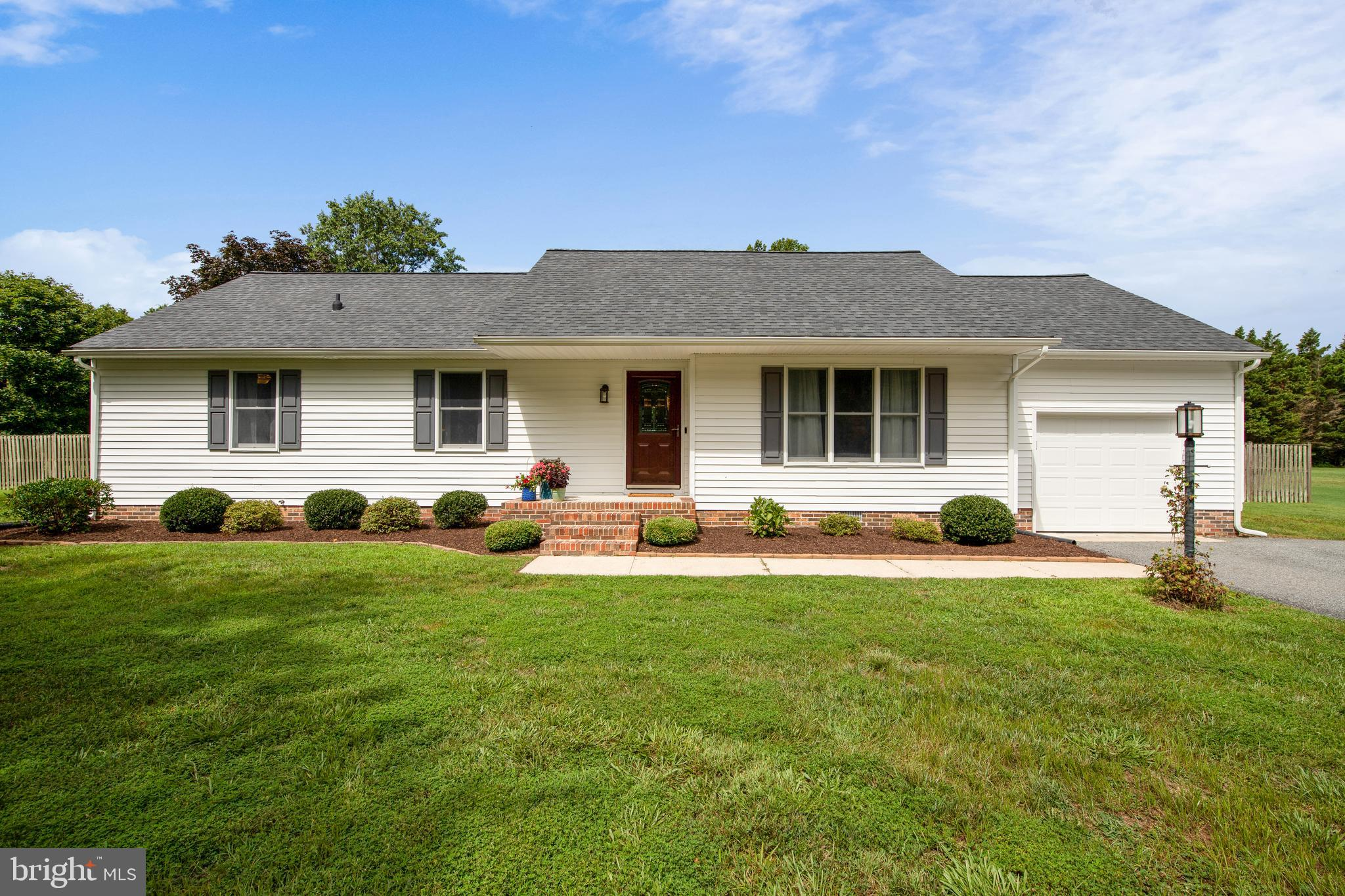 Remarkable rancher with hardwood flooring throughout PLUS an updated kitchen with stainless steel ap
