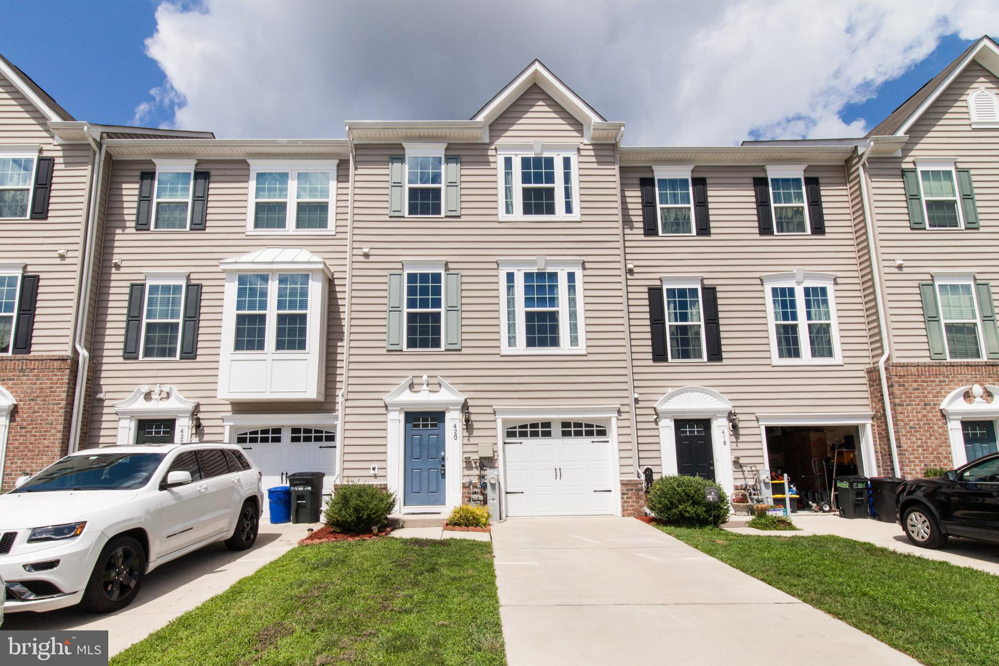 Well Maintained 4 Bedroom and 3 1/2 Bathroom Town Home. Hardwood floors in foyers with two Coat Clos