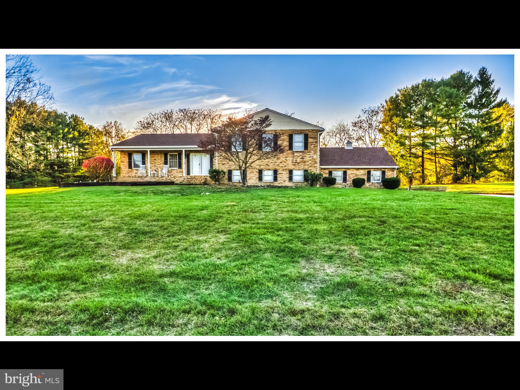 Beautiful, updated split level situated on perfect 2 acre lot in the rarely available Brookmead Farm