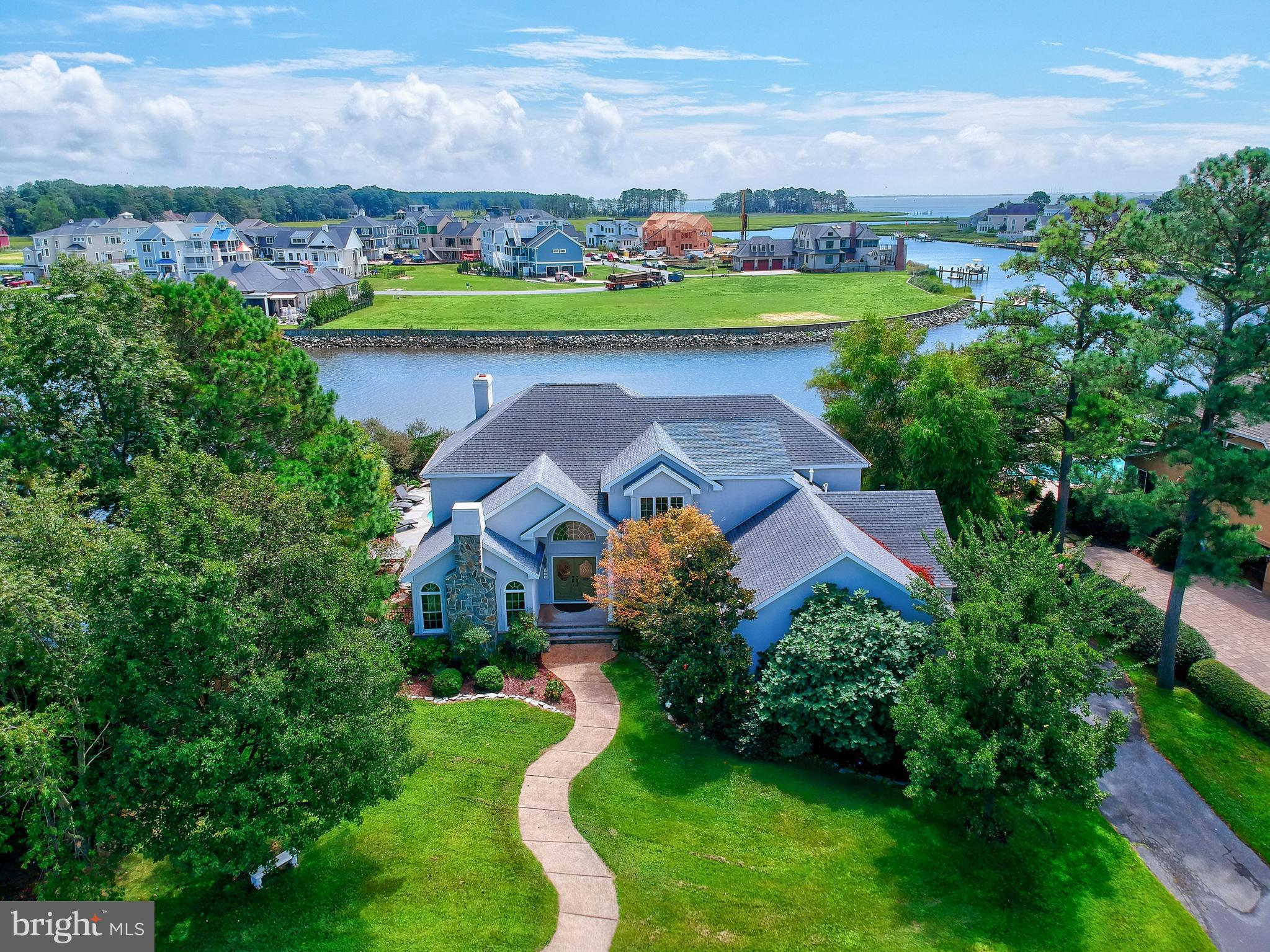 Entertainer's Delight- This resort style waterfront Rehoboth Beach Yacht & CC home with backyard oas