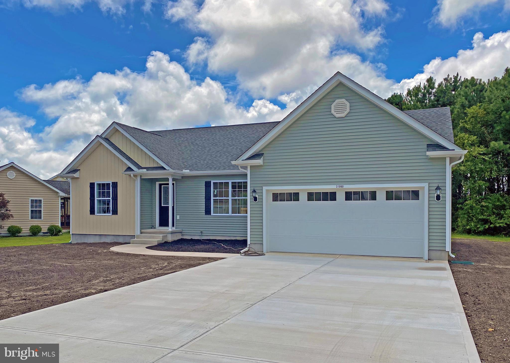 NEW CONSTRUCTION* - - Ready for your immediate occupancy! This popular open concept floor plan has t