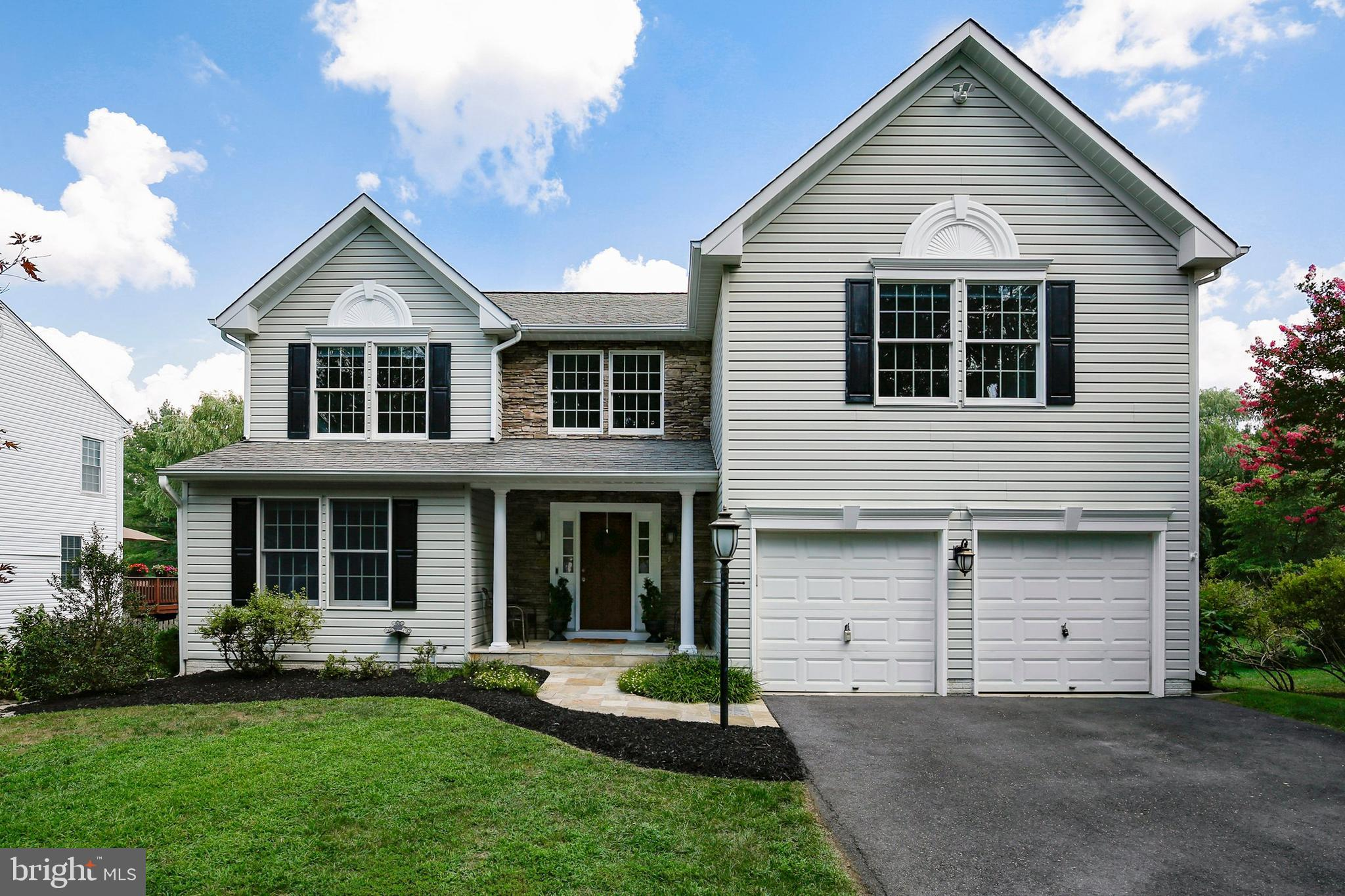 Stunning colonial located on a premium lot with a flat back yard that goes forever! This home has up