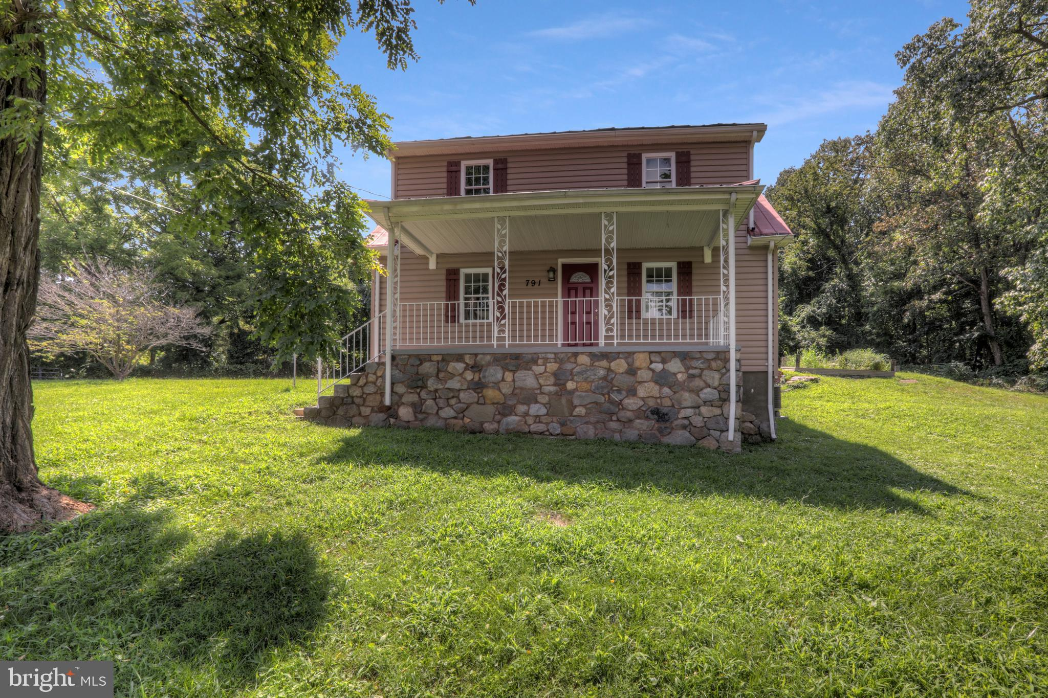 Adorably Renovated 3 Bedroom 2 Bath home resting on 2/3 acres of land in the beautiful Harpers Ferry