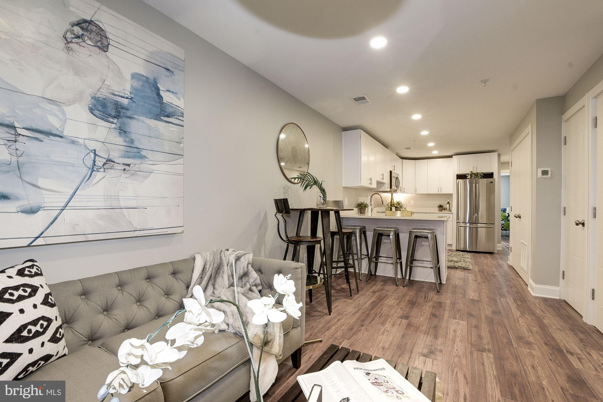 LAST UNIT LEFT IN THE PROJECT! Awesome new 16-unit ELEVATOR ACCESSIBLE condo offers modern & classic