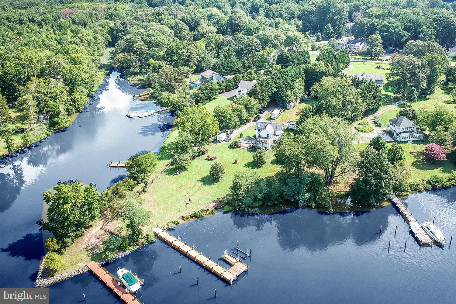 RARE WATERFRONT OPPORTUNITY ON CADLE CREEK spilling into the Bay via the Rhode River!  80 feet of prime water frontage with L-shaped pier and electric lift.  Dangle your legs off the pier while fishing!  Bask in spectacular sunsets!  Original Mayo creekside home circa 1892, maintained and preserved in a pride of ownership Chesapeake tradition.  Verdant, treed 1.46 acres with level lawns.  Multi-vehicle driveway and extra parking for recreational vehicles/boat trailers or possible home business.  Enjoy outdoor living with welcoming screened porch spanning front of home, water view dining deck and yard with brick BBQ grill ready for picnics and play!  Living Room opening to deck & waterfront.  Formal chandeliered Dining Room.  Updated Country Kitchen with cooktop island dining bar & stainless appliances.  Home Office or homeschooling room.  Vaulted skylit Master Suite with decorative tile Bath.  Rooftop water view decking for morning coffee or evening stargazing!  Decorate this storied Bay home to your taste and settle in for SERENE YEAR-ROUND LIVING or a SUMMERTIME FAMILY RETREAT!