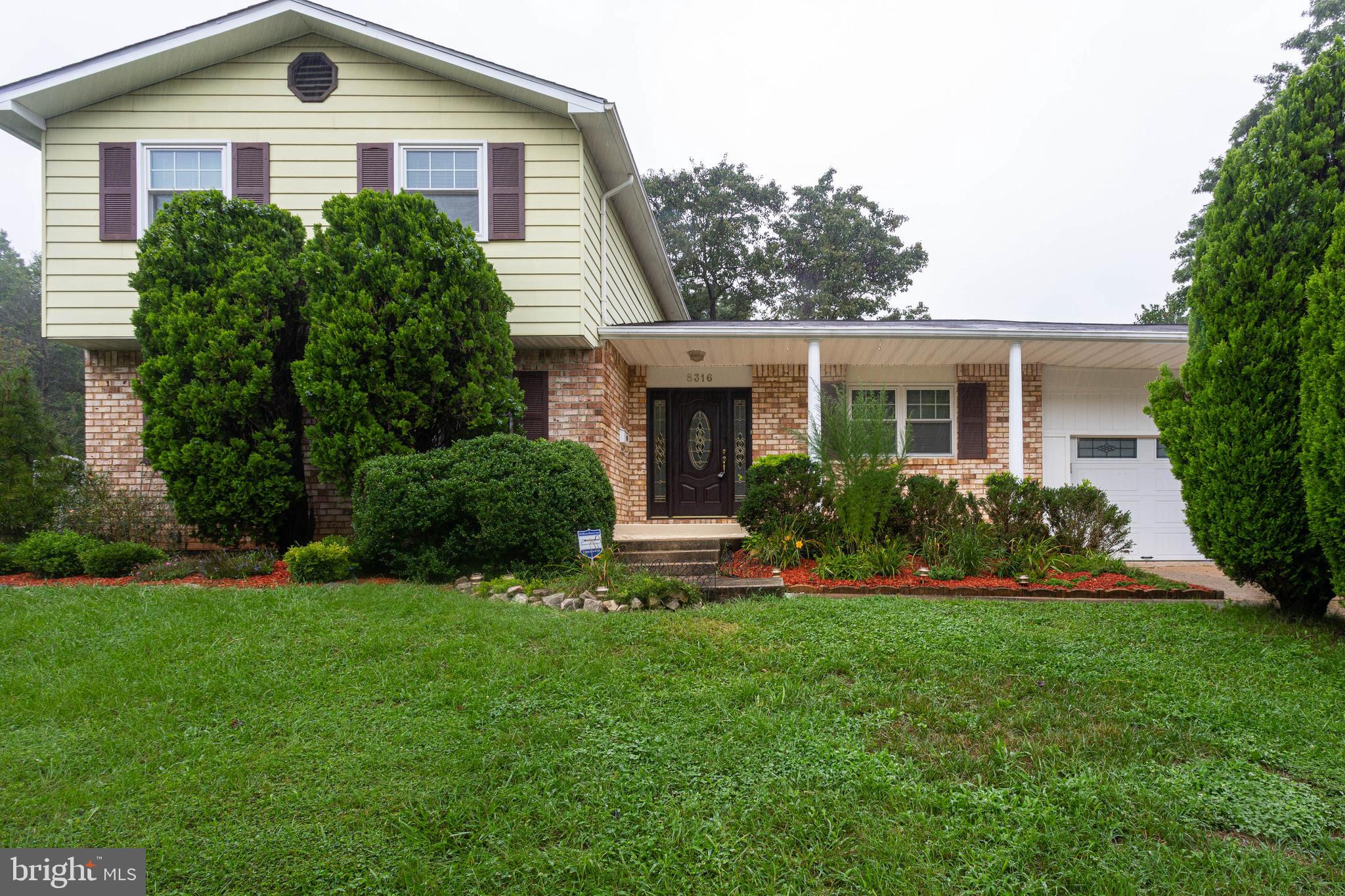 Spacious split level home with basement located in great neighborhood.  This home features 4 large B