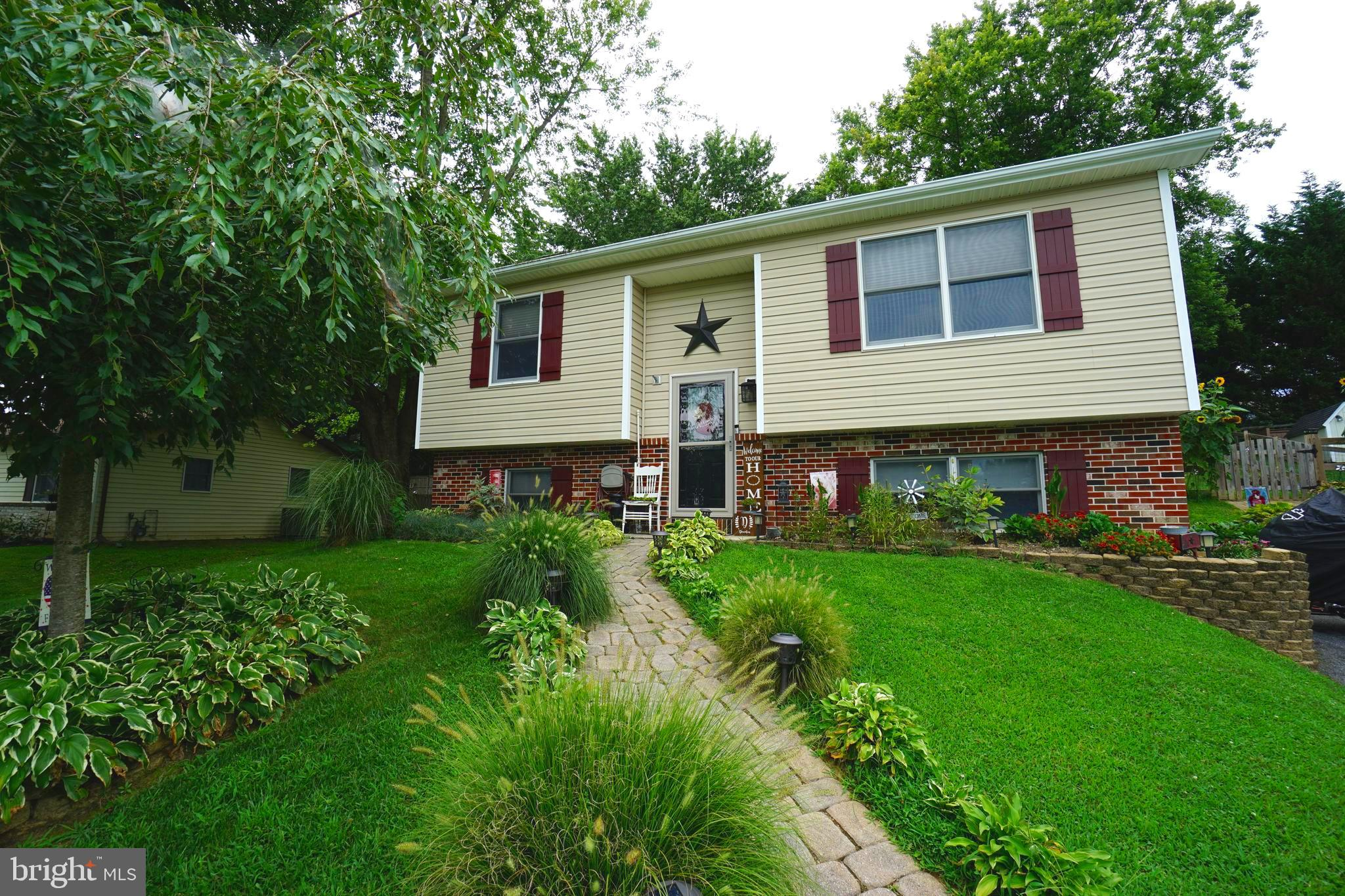 IMMACULATELY MAINTAINED THREE BEDROOM, ONE BATH, SPLIT LEVEL WITH BACKYARD OASIS. TWO MAIN LEVEL BED