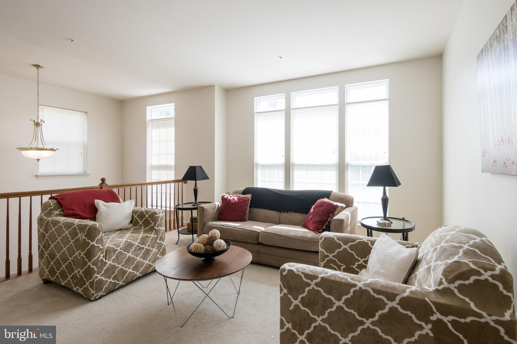 15 years young and this end unit townhome sparkles.  Just freshly painted inside and out.  Tall wind