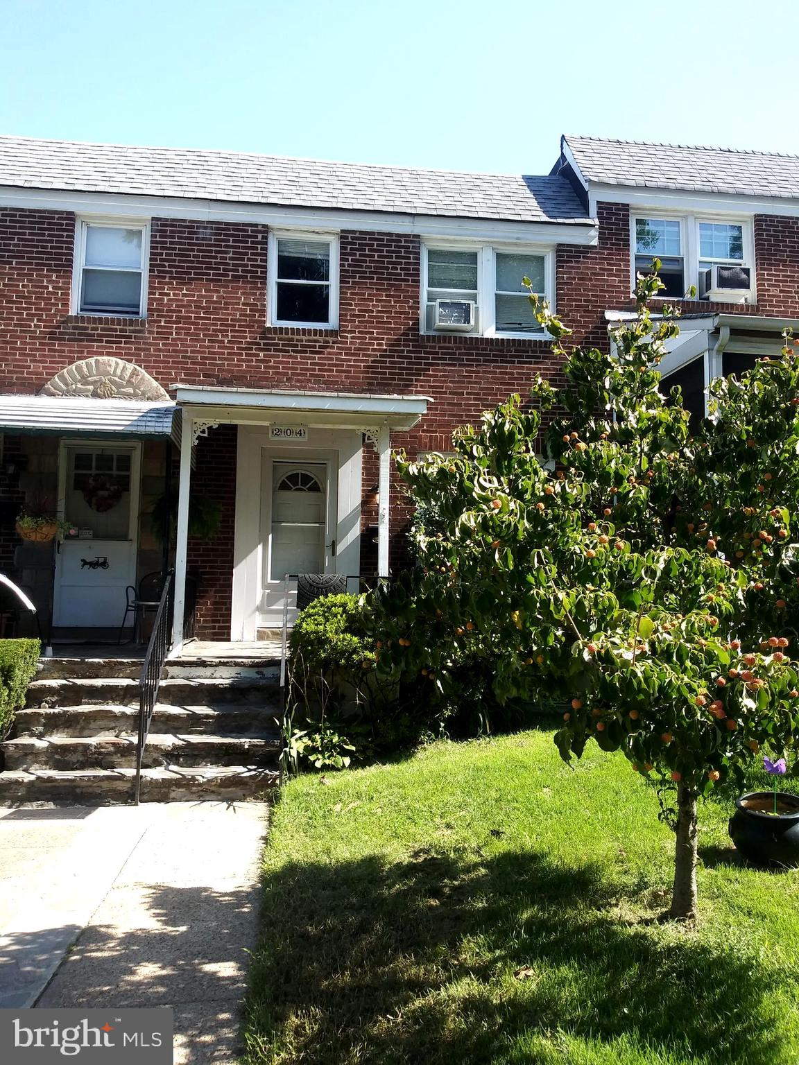 REDUCED  -    3 BEDROOM  1-1/2 BATH BRICK TOWNHOUSE  WITH LARGE COVERED ADDITION OFF KITCHEN.  NOTE: WHEN BACK PORCH WAS ADDED THEY ALSO EXTENDED THE BASEMENT AREA.    WOOD FLOORS,  AND NEW CARPETING, FRESHLY PAINTED, 2+ CAR PARKING PAD IN REAR,  FULL BASEMENT HAS WALK OUT TO REAR YARD AND 1/2 BATH .
