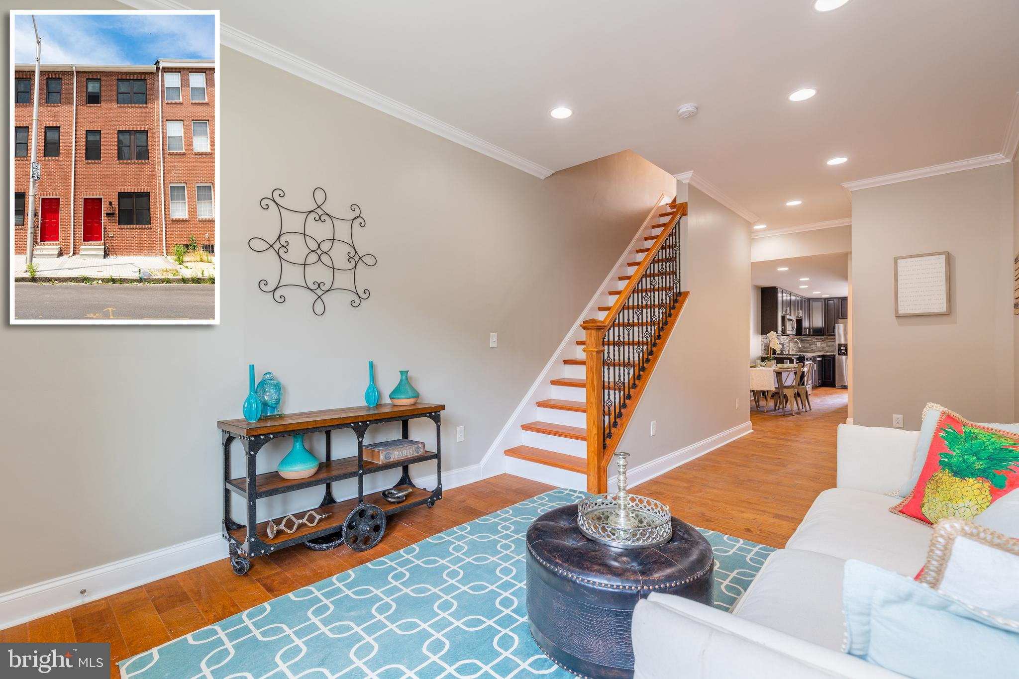 PICTURE PERFECT RENOVATION BY HomeFree-USA WITH 3 FINISHED LEVELS & OFF STREET PARKING! Gleaming har